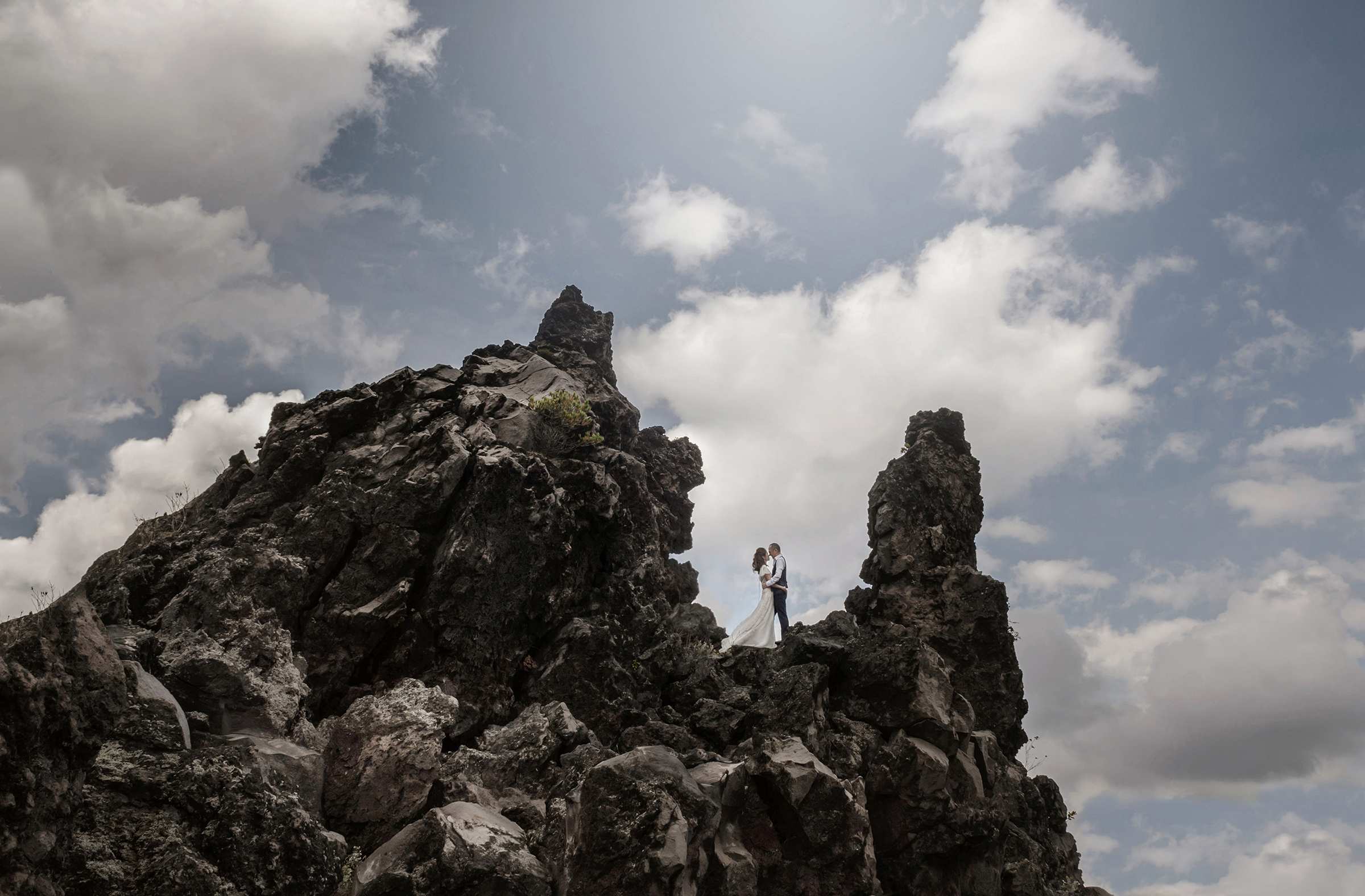 Wedding couple on mountaintop - photo by 37 Frames