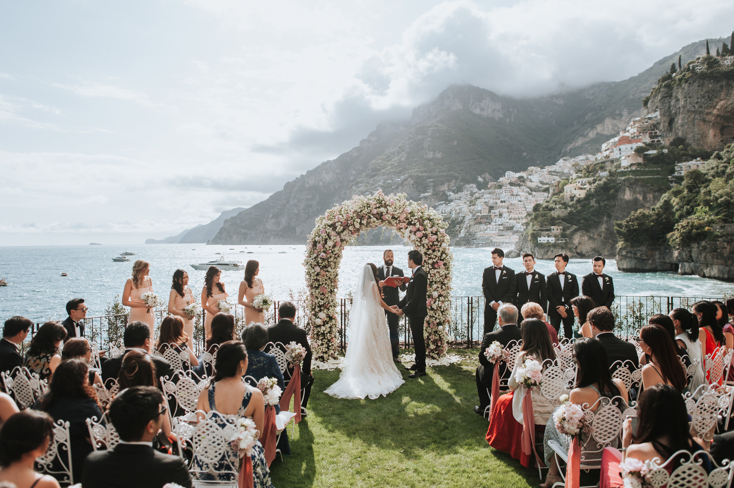 Wedding ceremony in front of lake and mountains. Photo by MunKeat Photography Studio