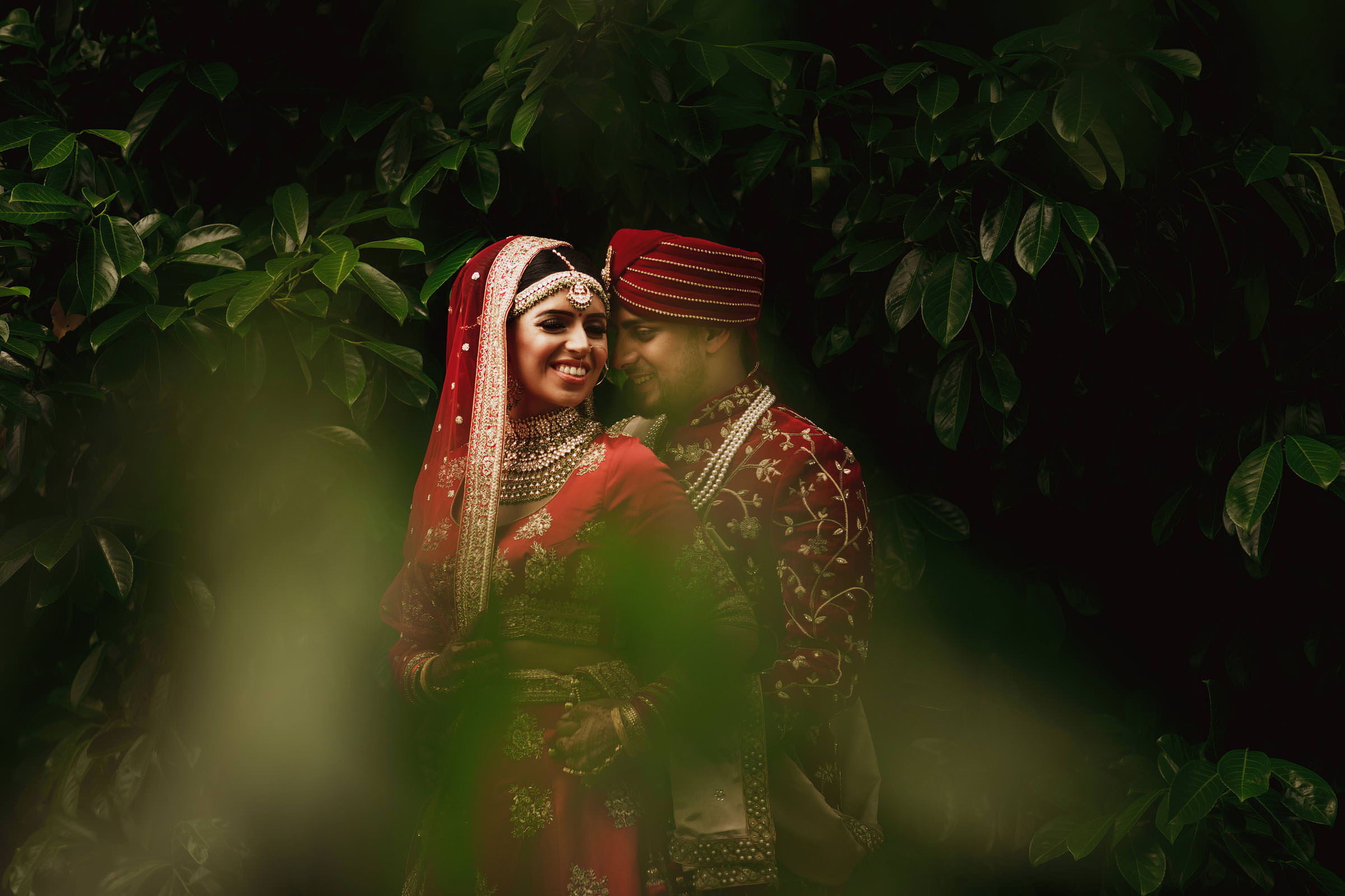 Bride and groom in garden - Photo by F5 Photography