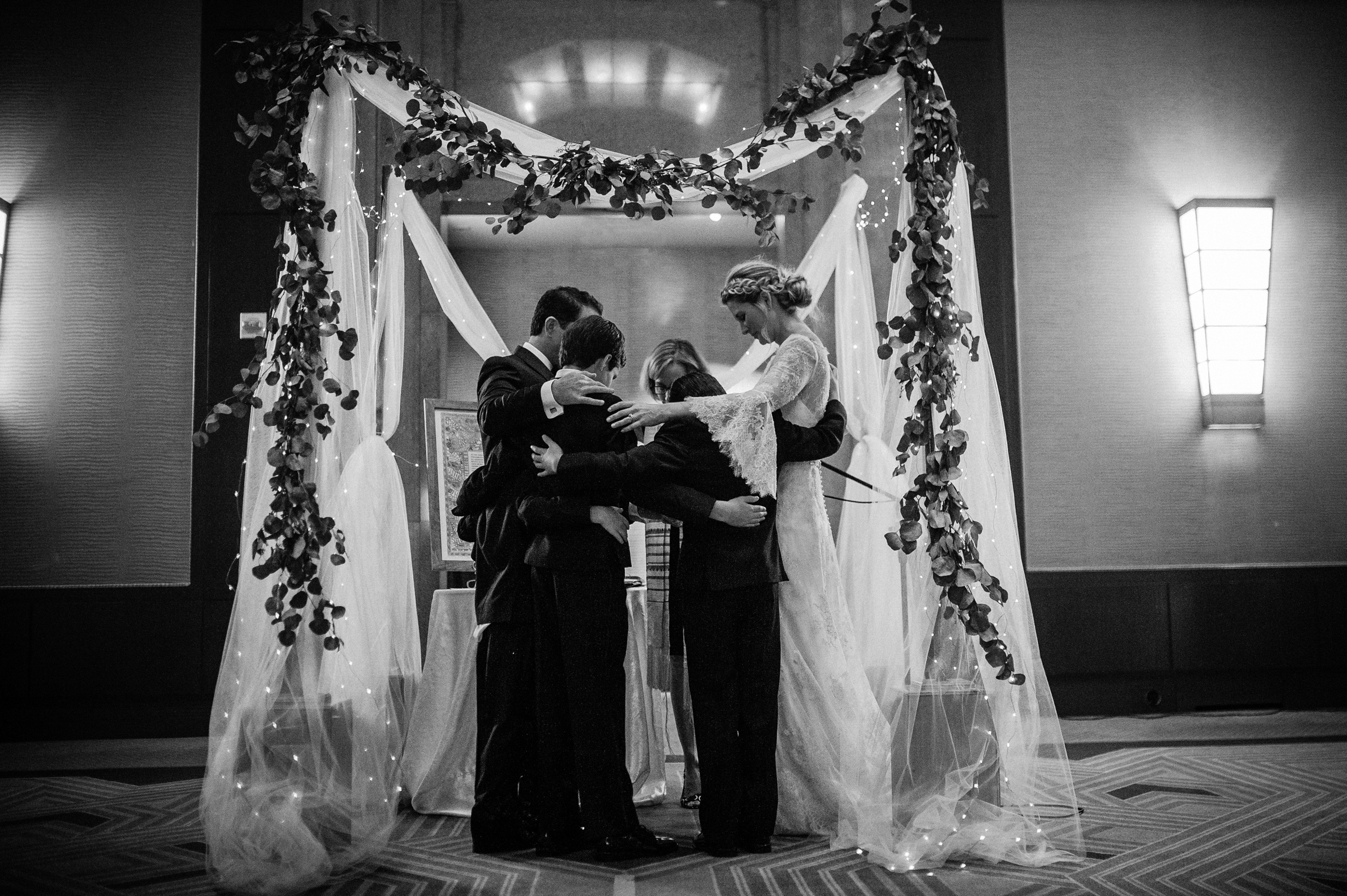 Bride and groom with moms under chuppah by Richard Israel