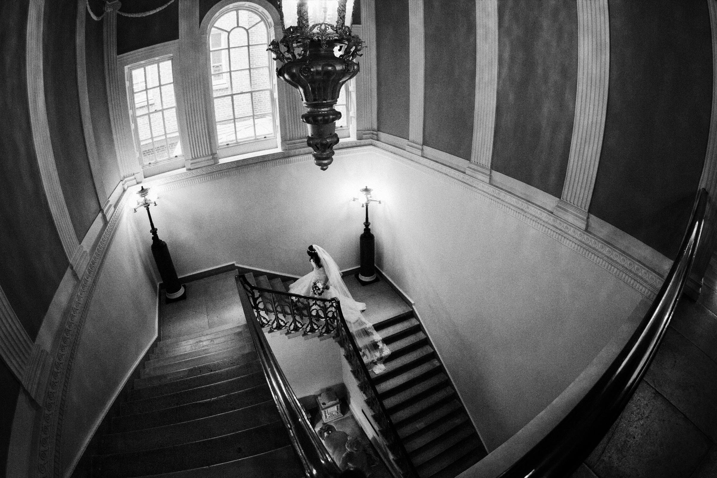 Bride ascending dramatic stairs by Jeff Ascough