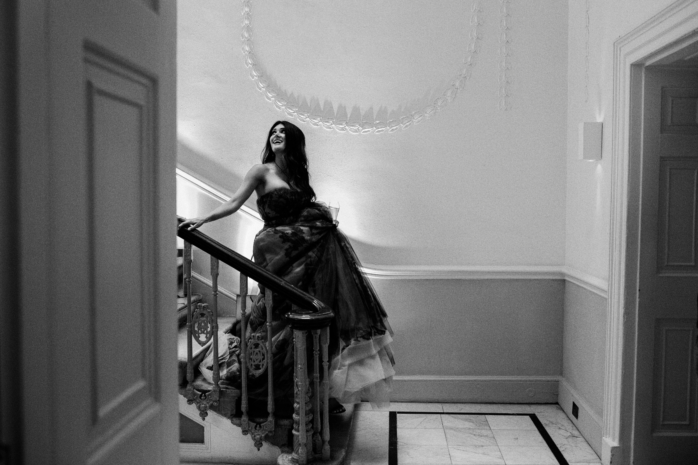 Bride descending stairs by Jeff Ascough