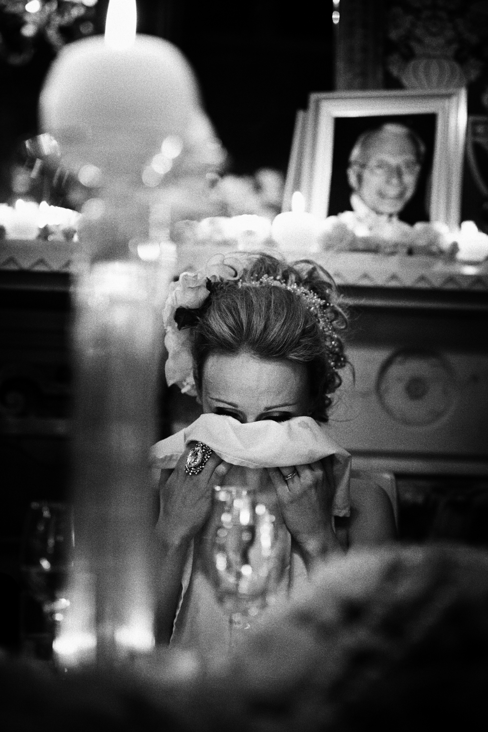 Bride dries here eyes with photo of father in background - photo by Jeff Ascough