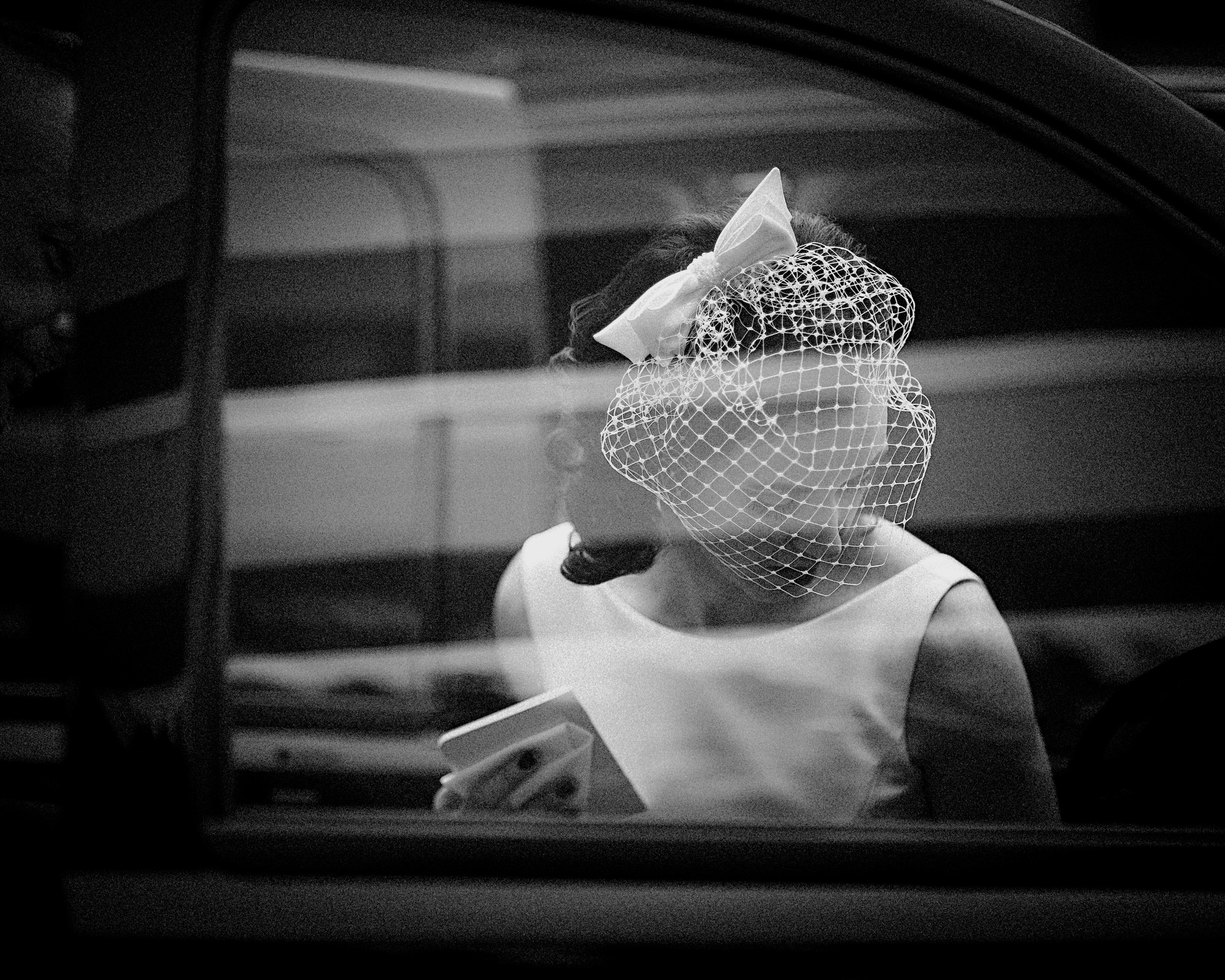 Bride in bird cage veil by Richard Israel