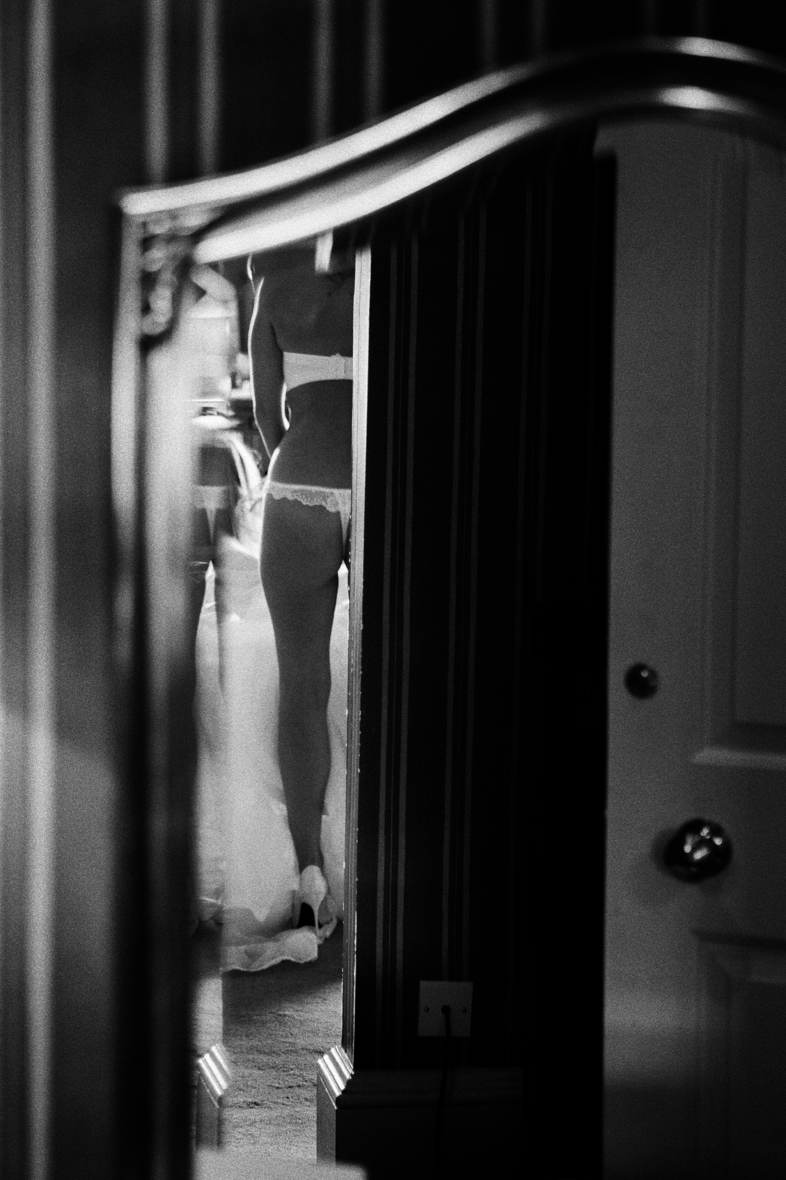 Bride in lacy lingerie in mirror by Jeff Ascough