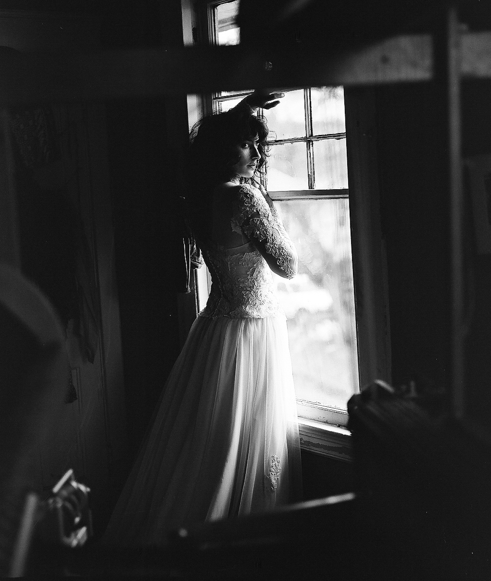 Bride posing by window by Richard Israel