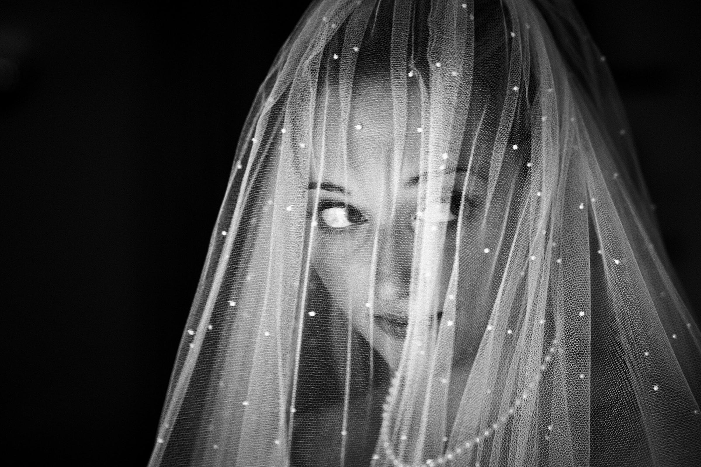 Bride under sparkling  veil - photo by Jeff Ascough