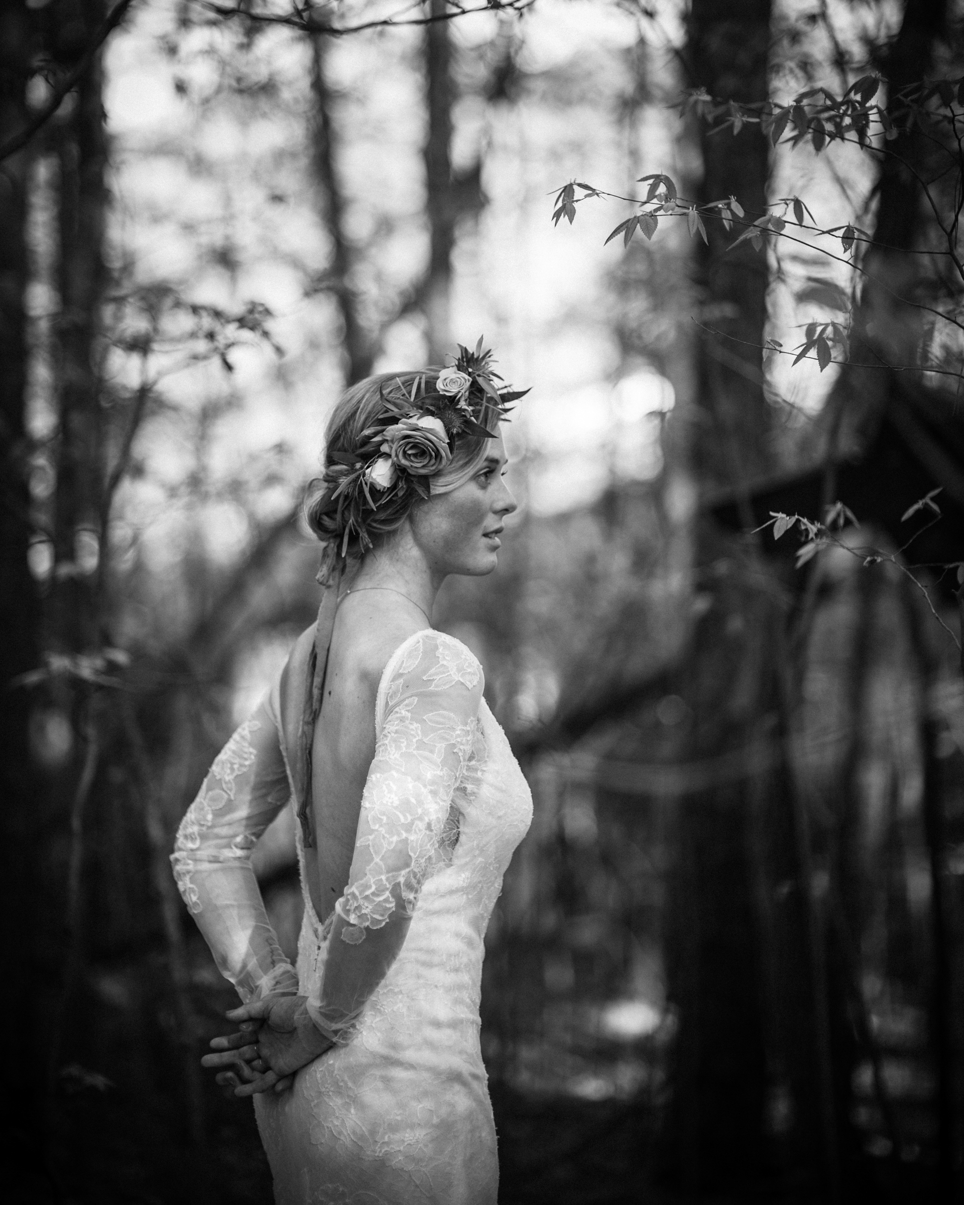 Bride with floral crown in forest by Richard Israel