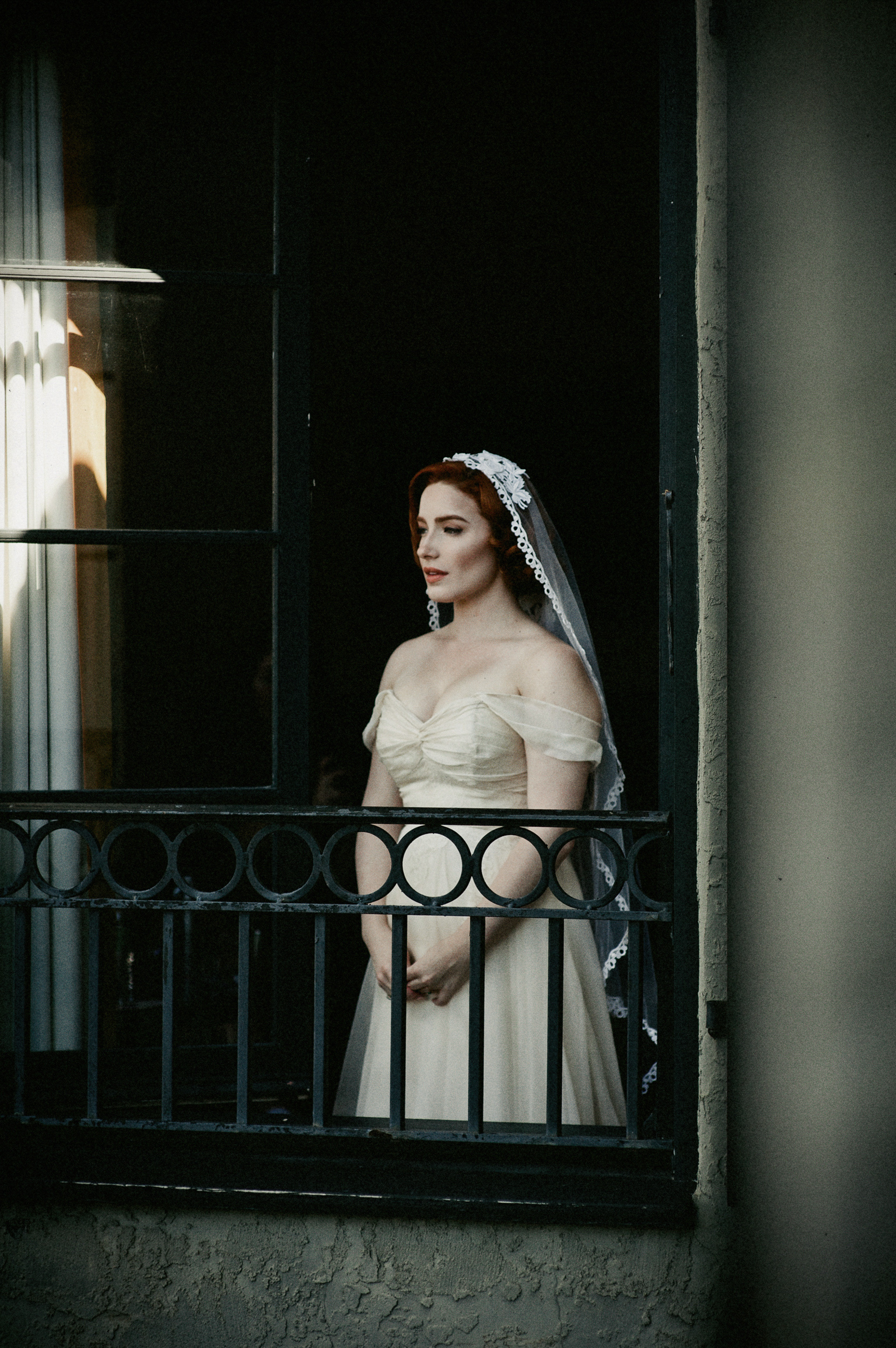 Classic portrait of red haired bride on balcony by Richard Israel Photography