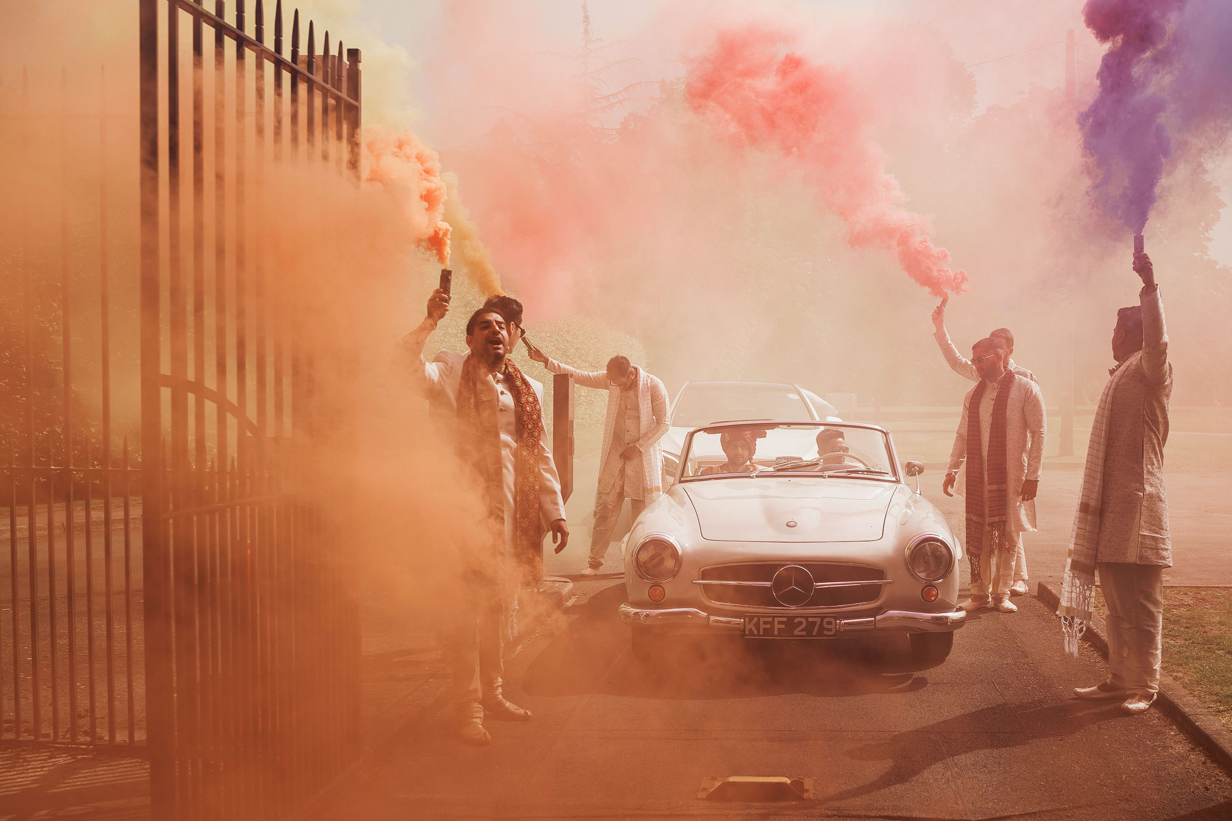 Colored smoke bombs escort car - Photo by F5 Photography