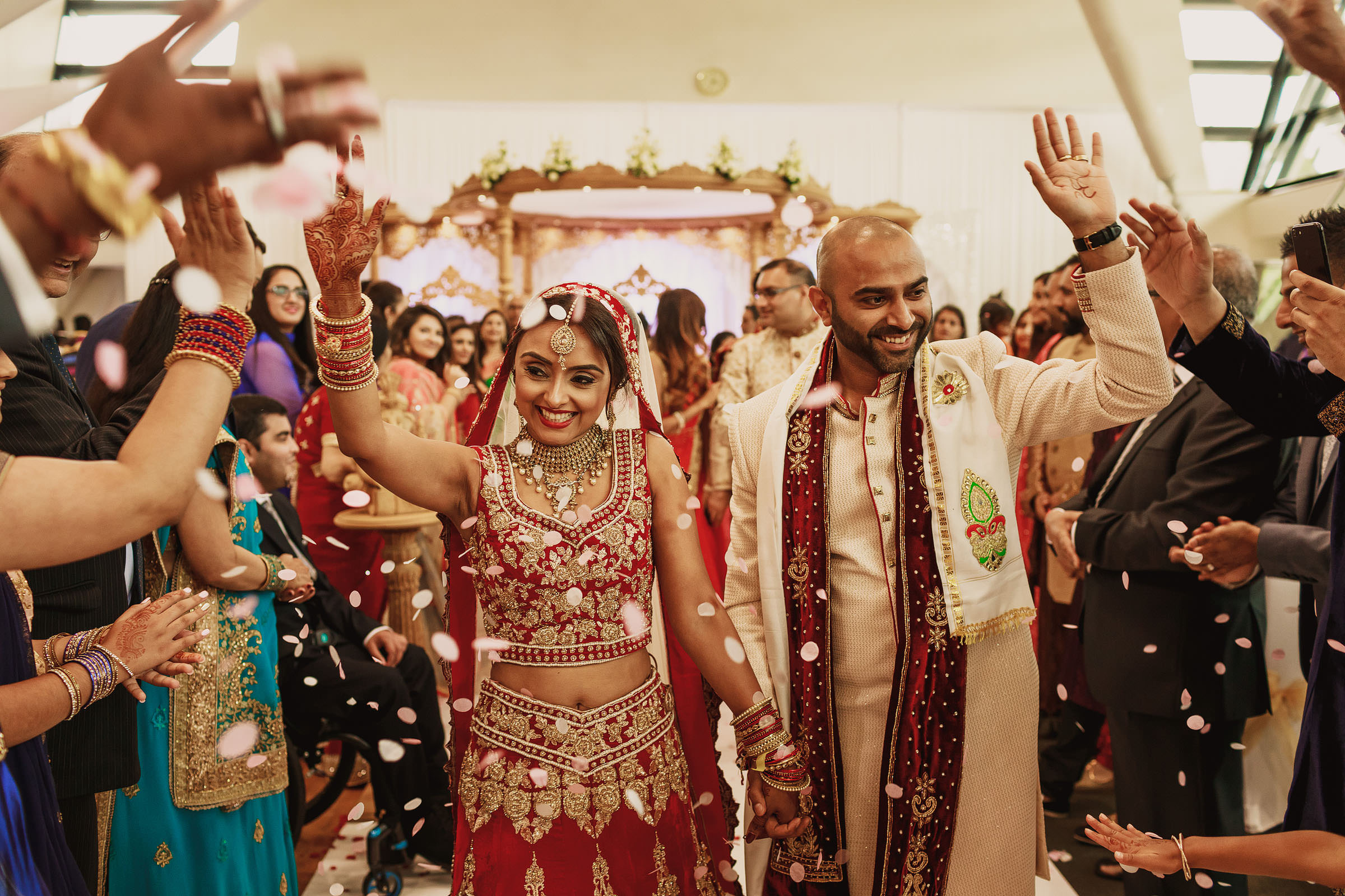 Couple exits among rose petals - Photo by F5 Photography