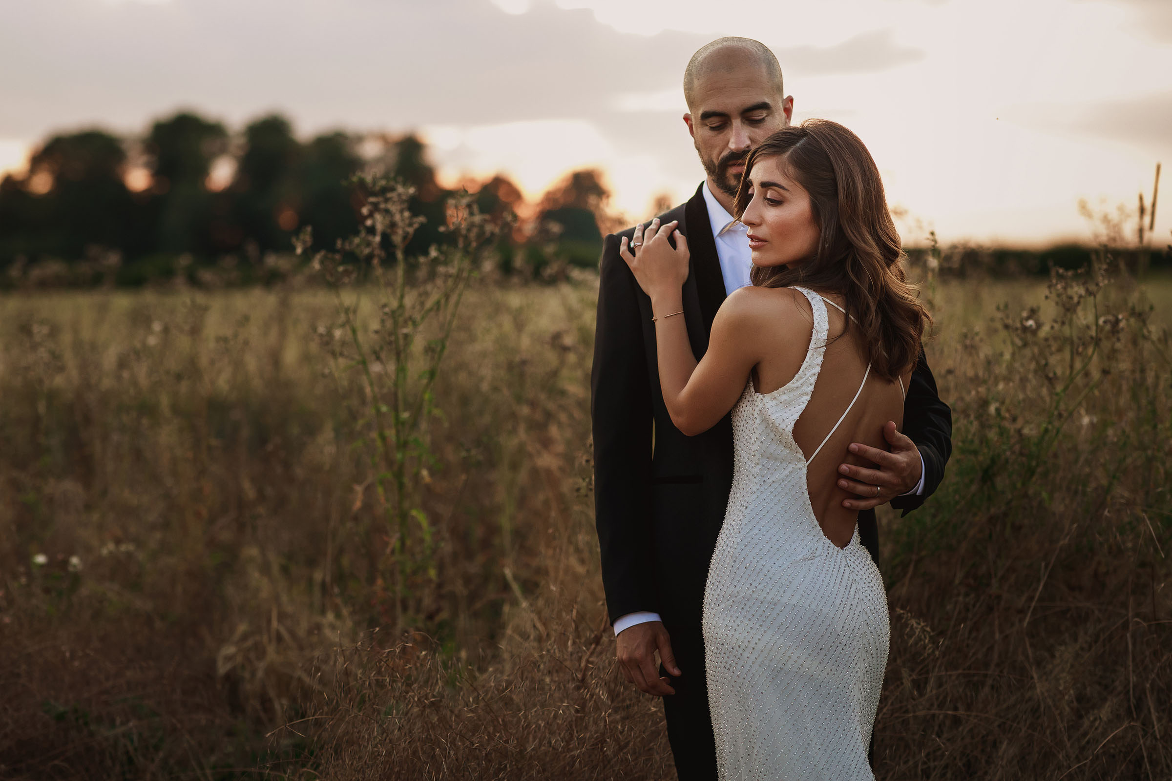 Couple portrait in a field - photo by F5 Photography