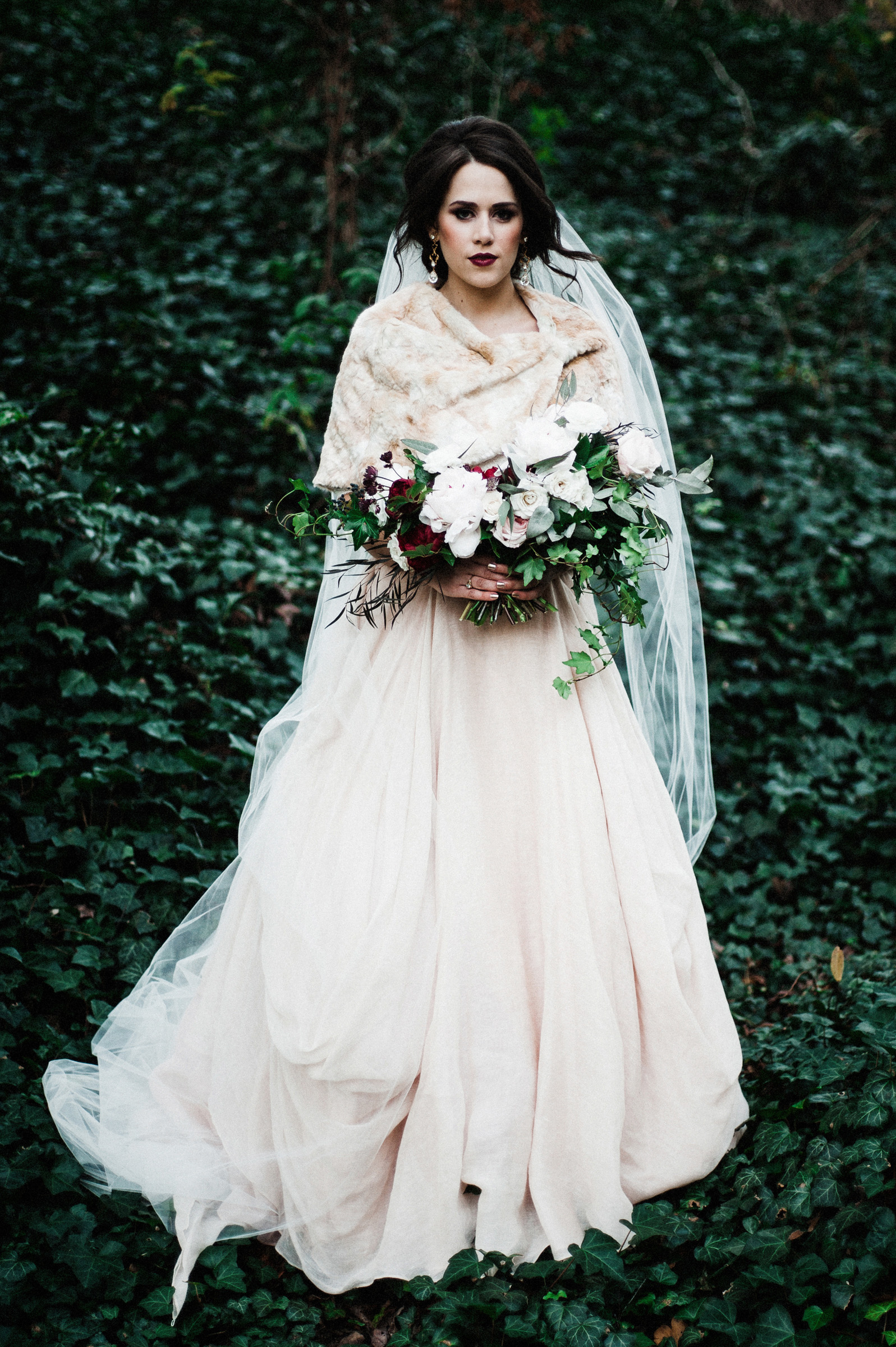 Dark haired bride with blush pink shawl and dahlia bouquet - photo by Richard Israel Photography