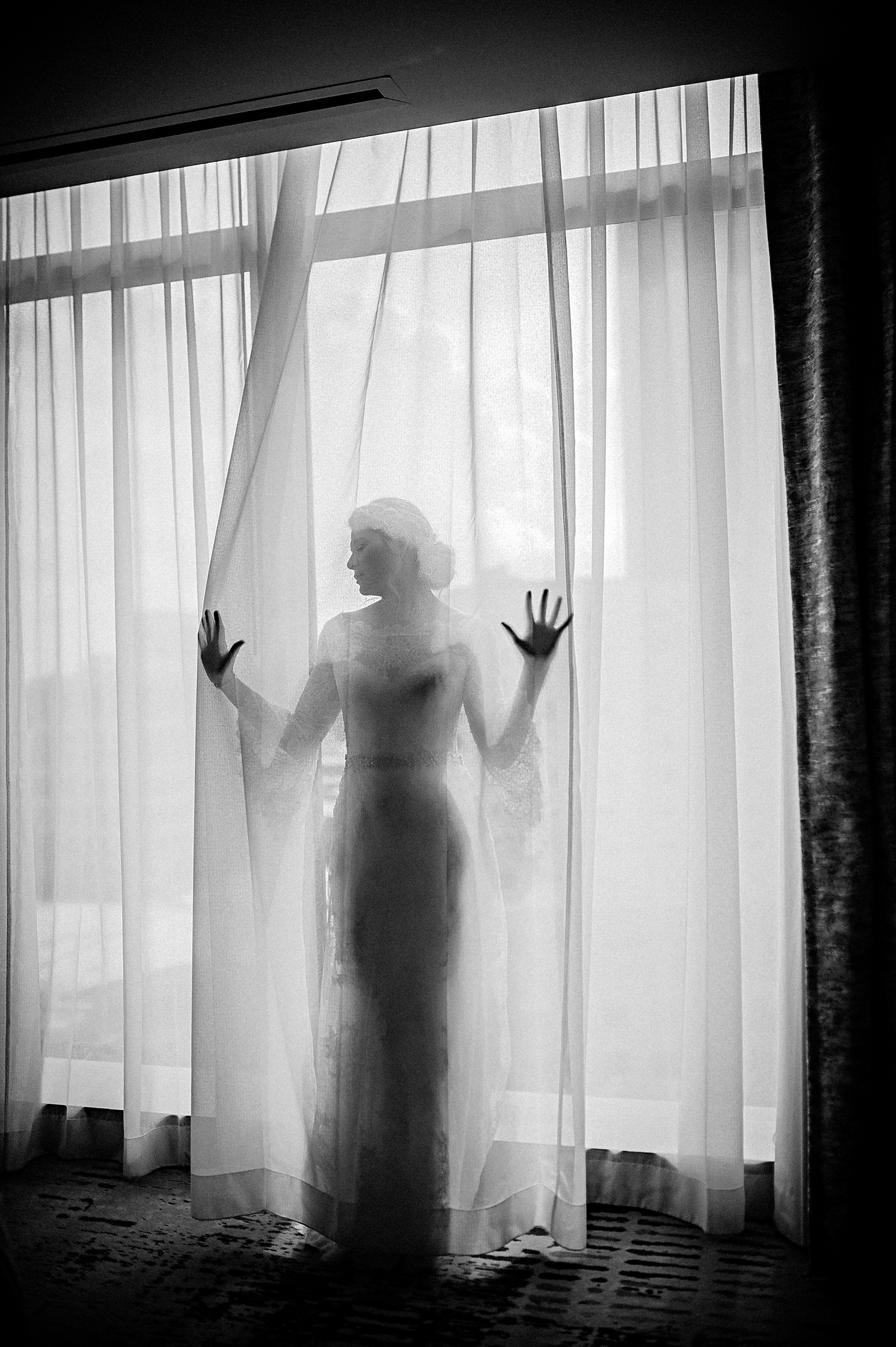 Ethereal moody bride by window by Richard Israel