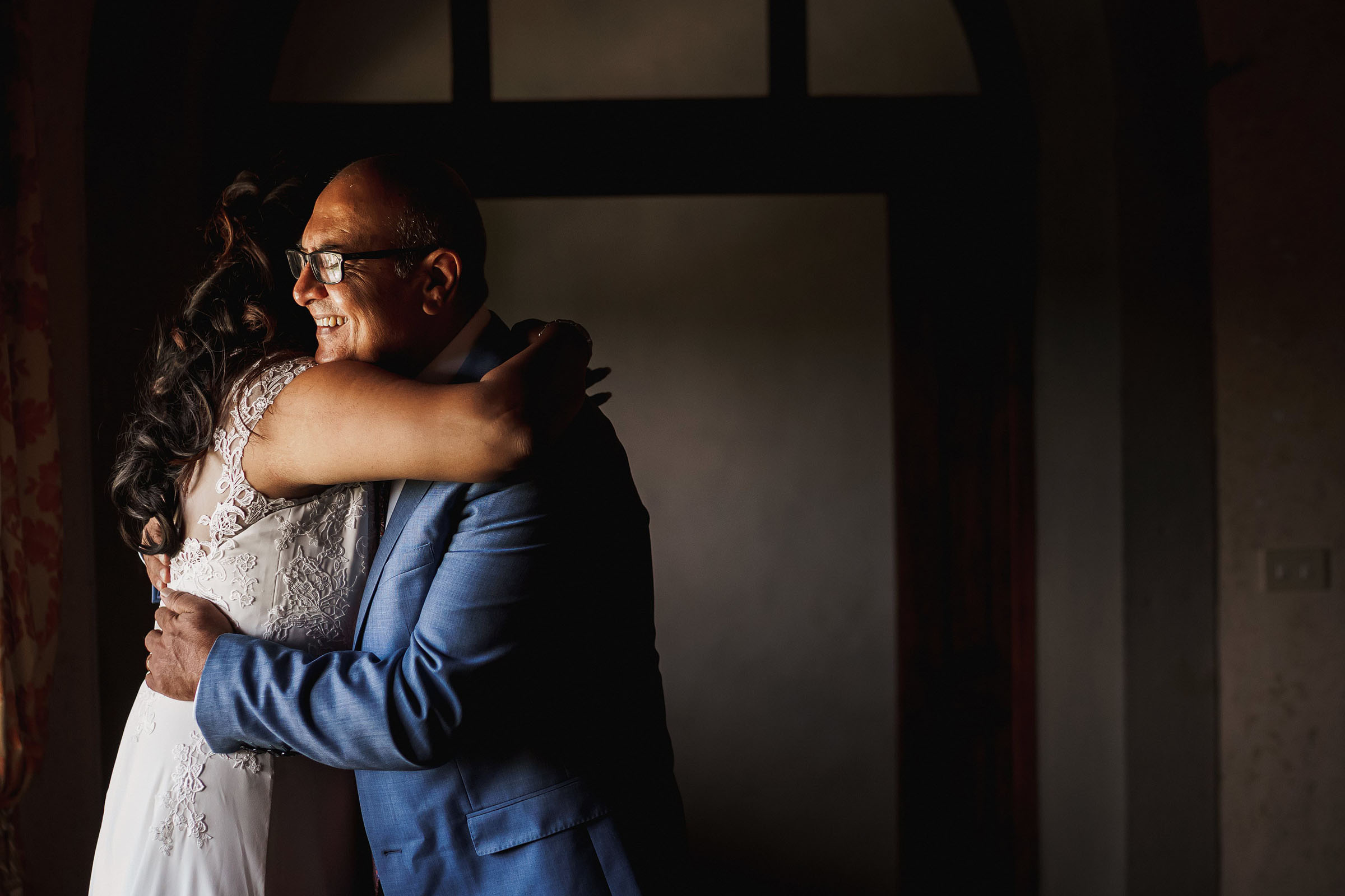 Father hugs his daughter before ceremony - photo by F5 Photography