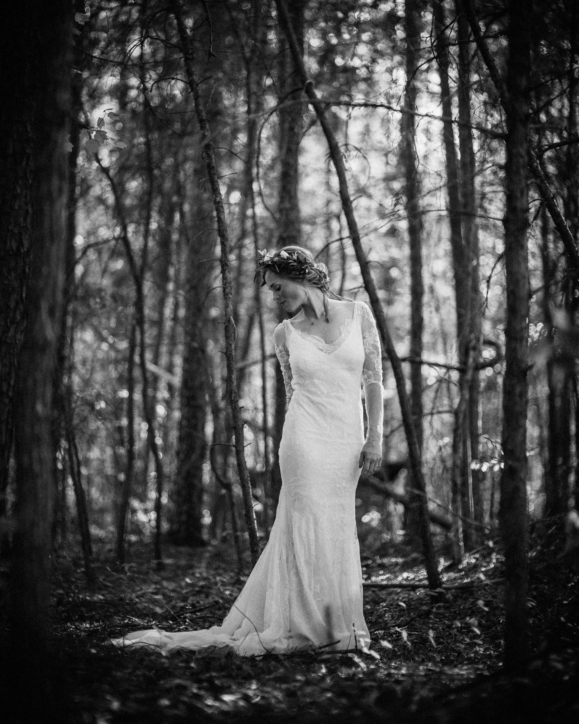 Film portrait of bride in lace sheath with updo - photo by Richard Israel Photography
