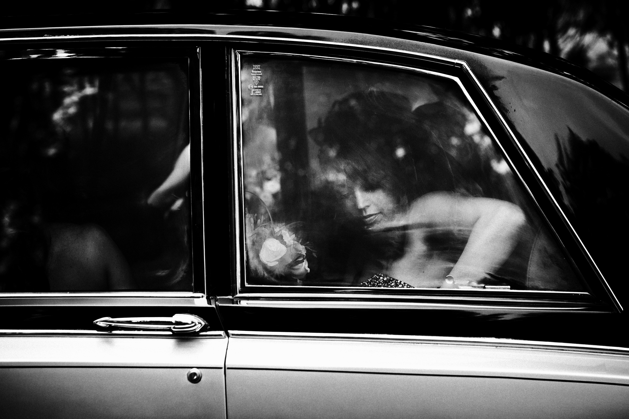 fleeting moment of bride in limousine - photo by Jeff Ascough
