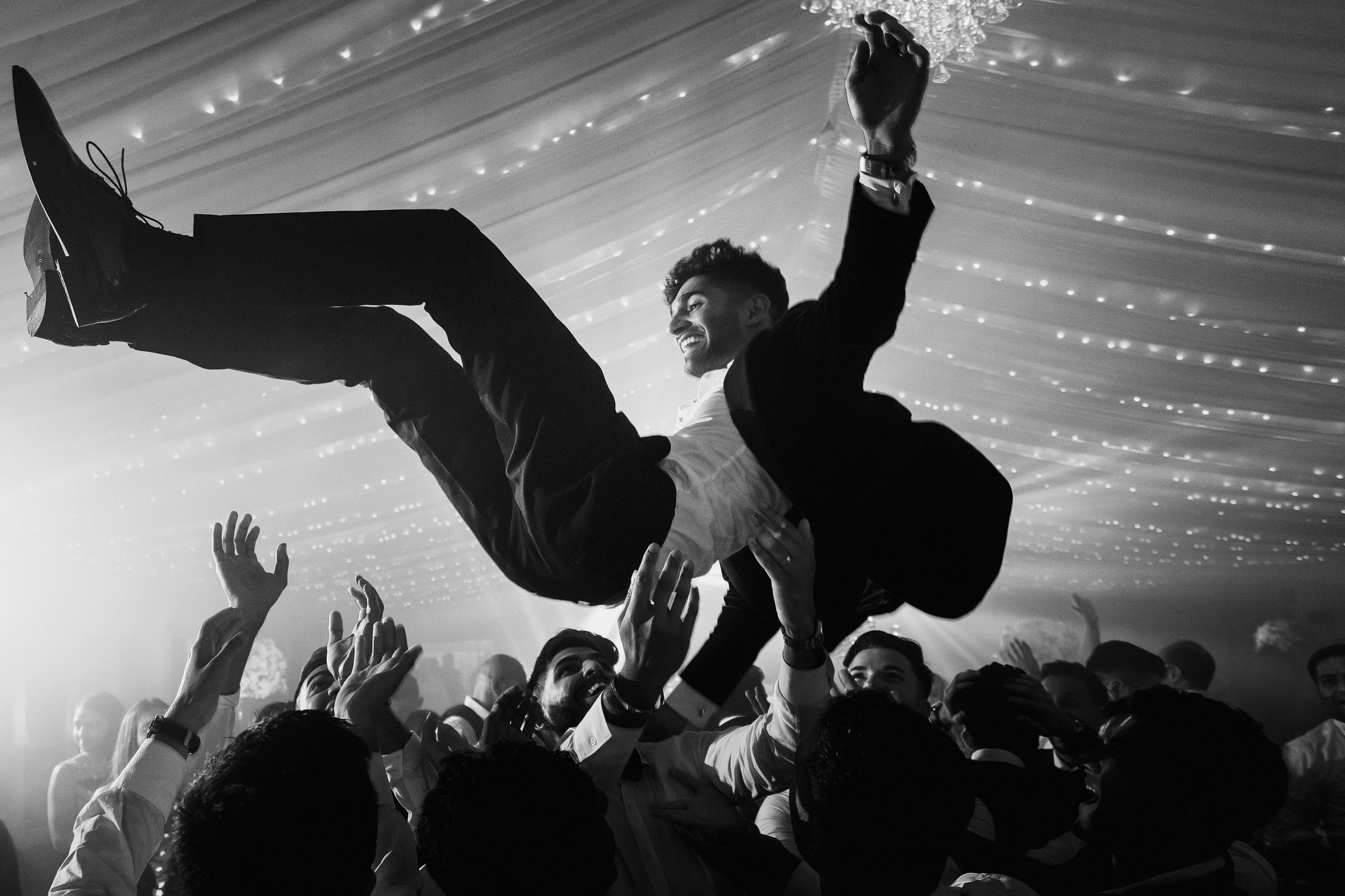 Groom at top of mosh pit -photo by F5 Photography