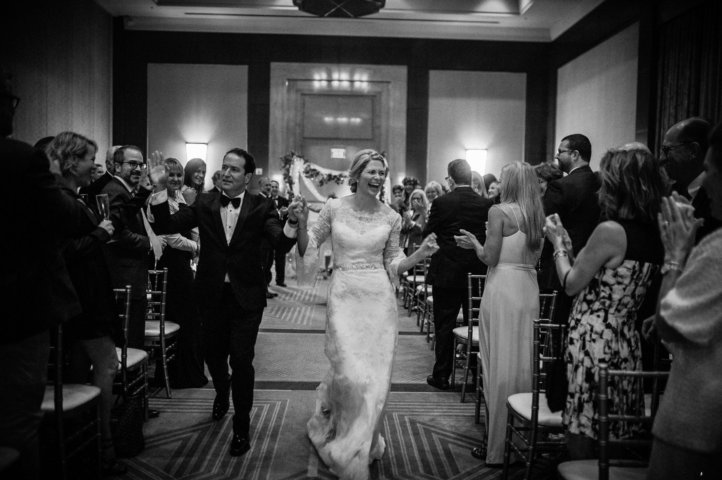 Happy couple in aisle - photo by Richard Israel Photography
