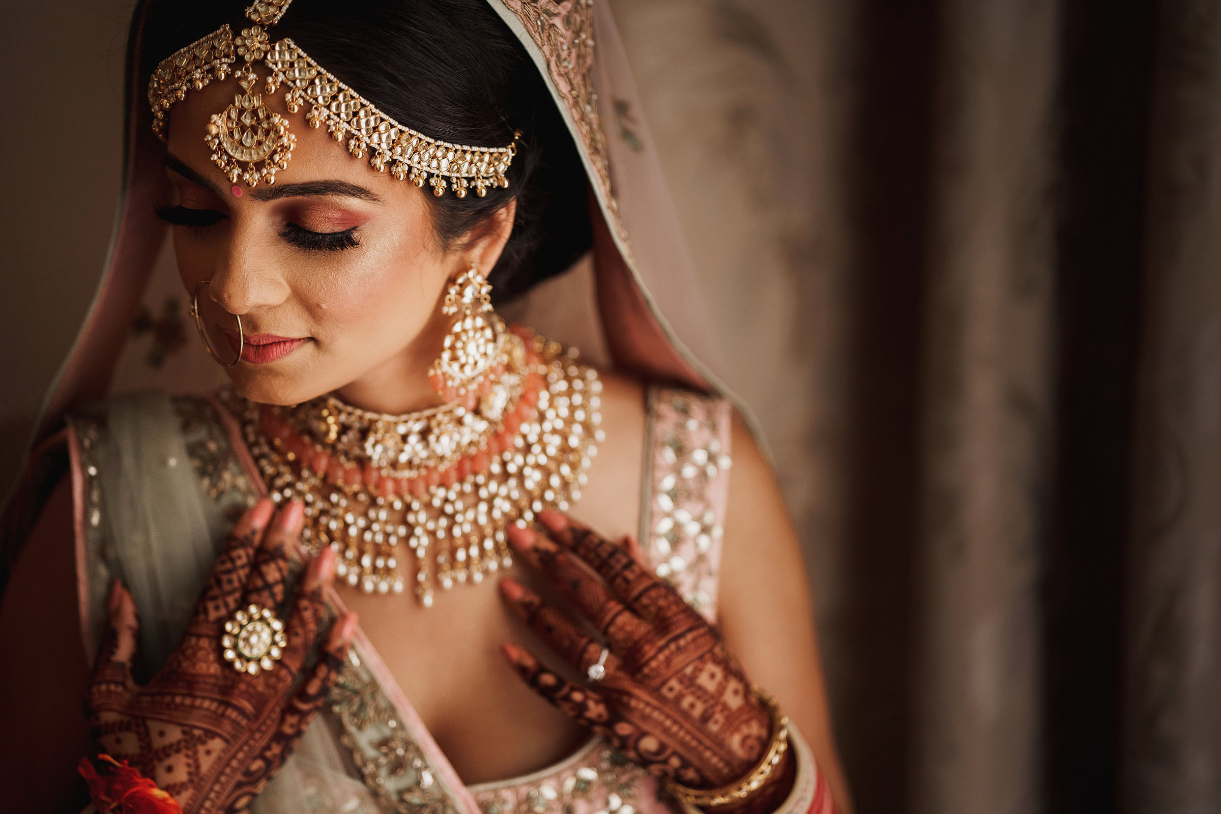 Indian woman with silver jewelry and henna hands - photo by F5 Photography