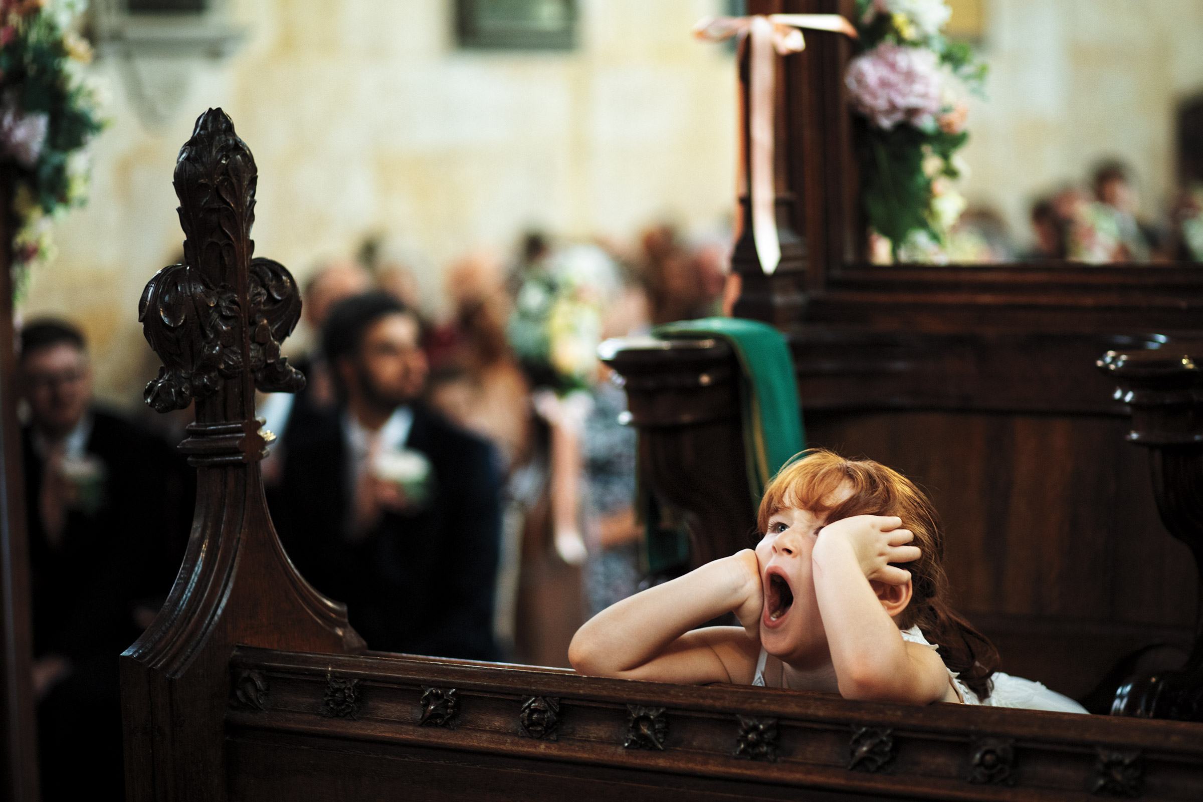 little girl yawning during ceremony - photo by Jeff Ascough