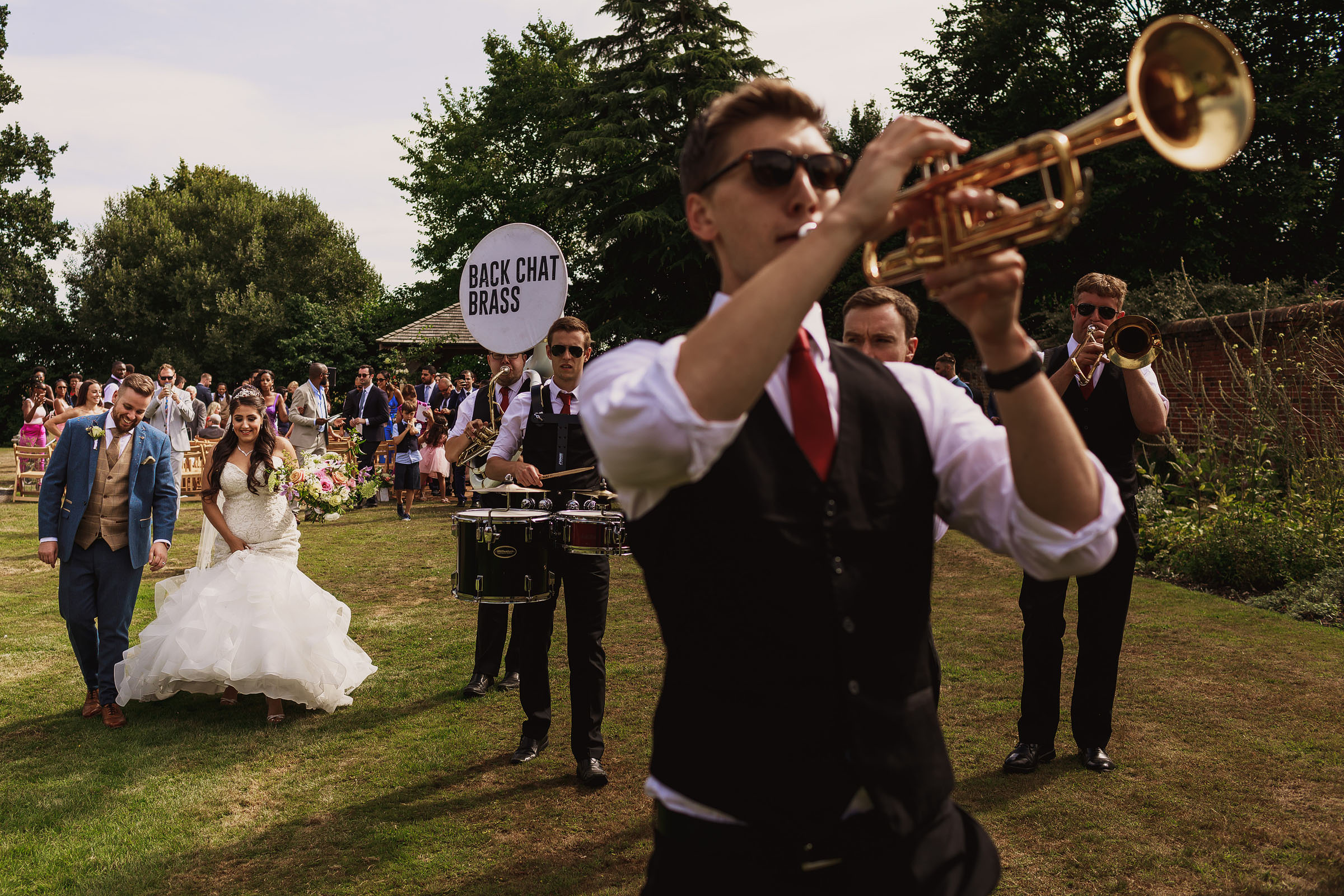Marching band leads bridal party - Photo by F5 Photography