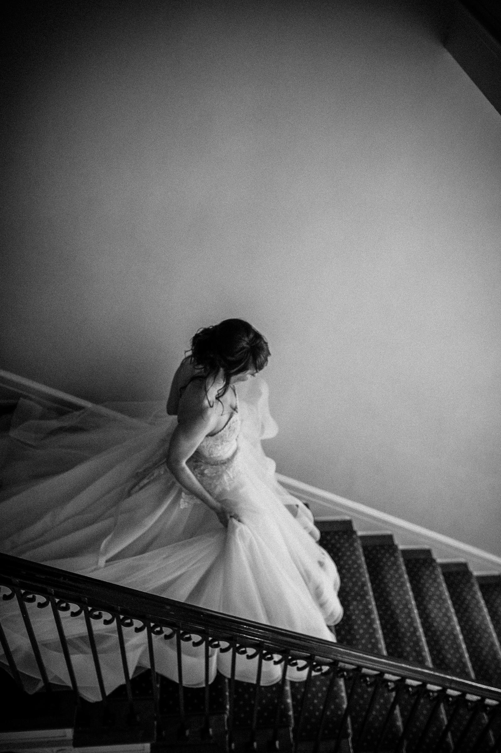 Moody bride descending stairs by Richard Israel