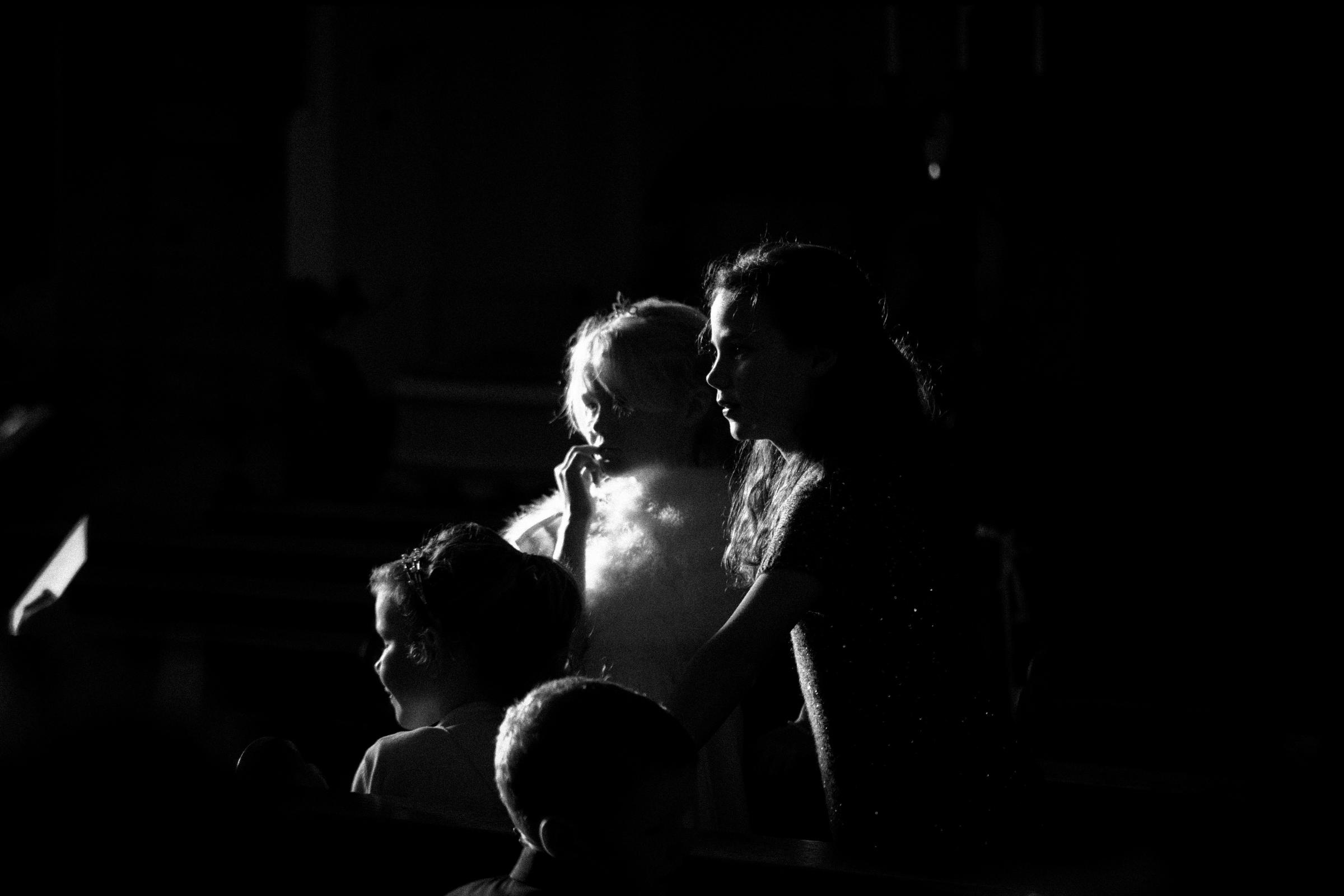 Moody portrait of kids in low key light by Jeff Ascough