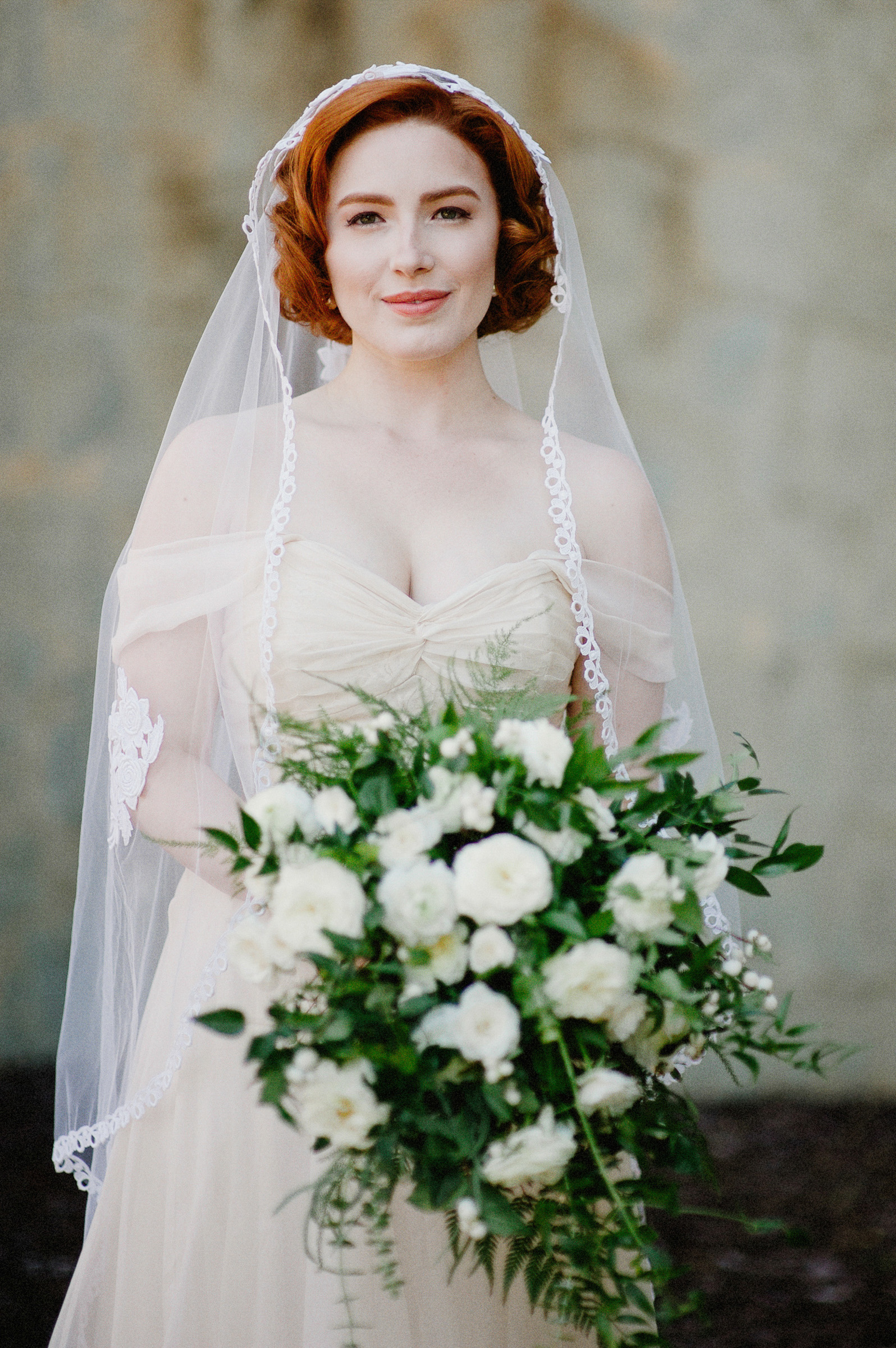 Portrait of stunning red haired bride with white rose bouquet - photo by Richard Israel Photography