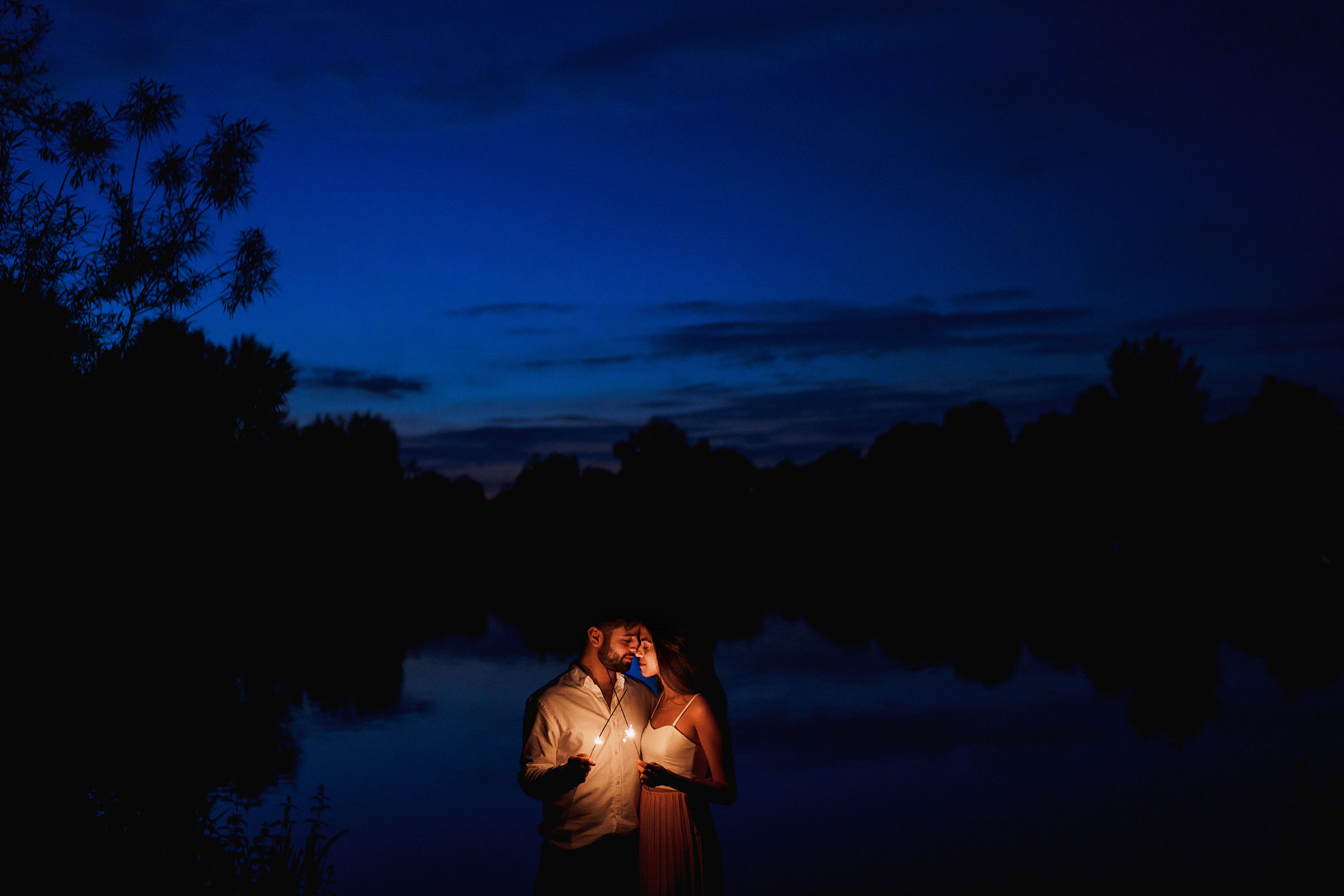 Romantic nighttime couple portrait - Photo by F5 Photography