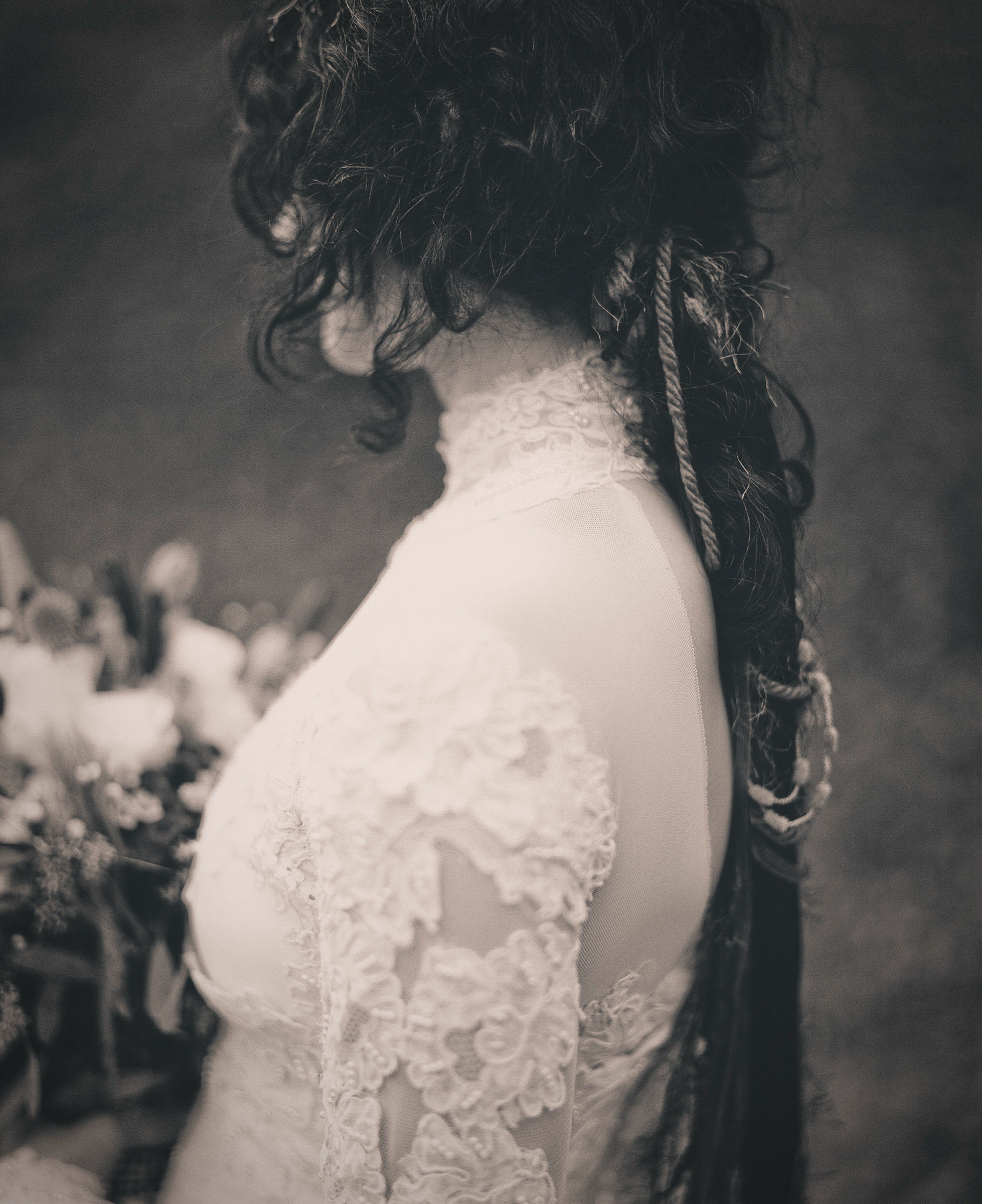 Sepia photo of bridal hair and dress detail by Richard Israel