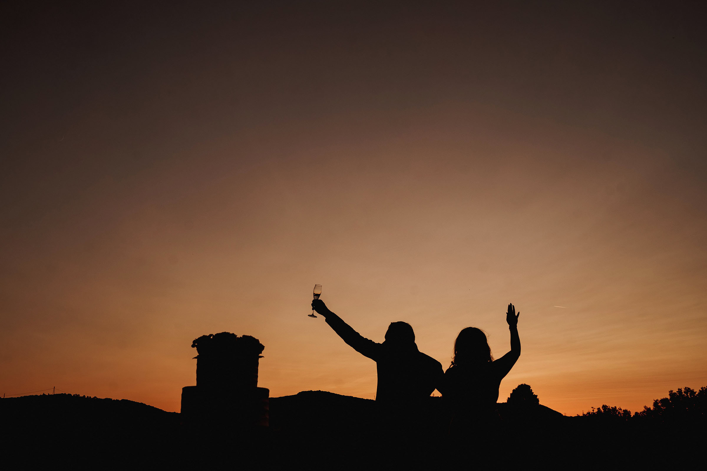 Sunset toast silhouette - Photo by F5 Photography