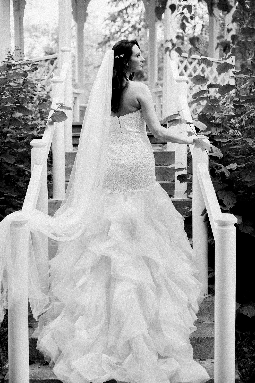 Back view bridal pose at gazebo - photo by Jurgita Lukos Photography