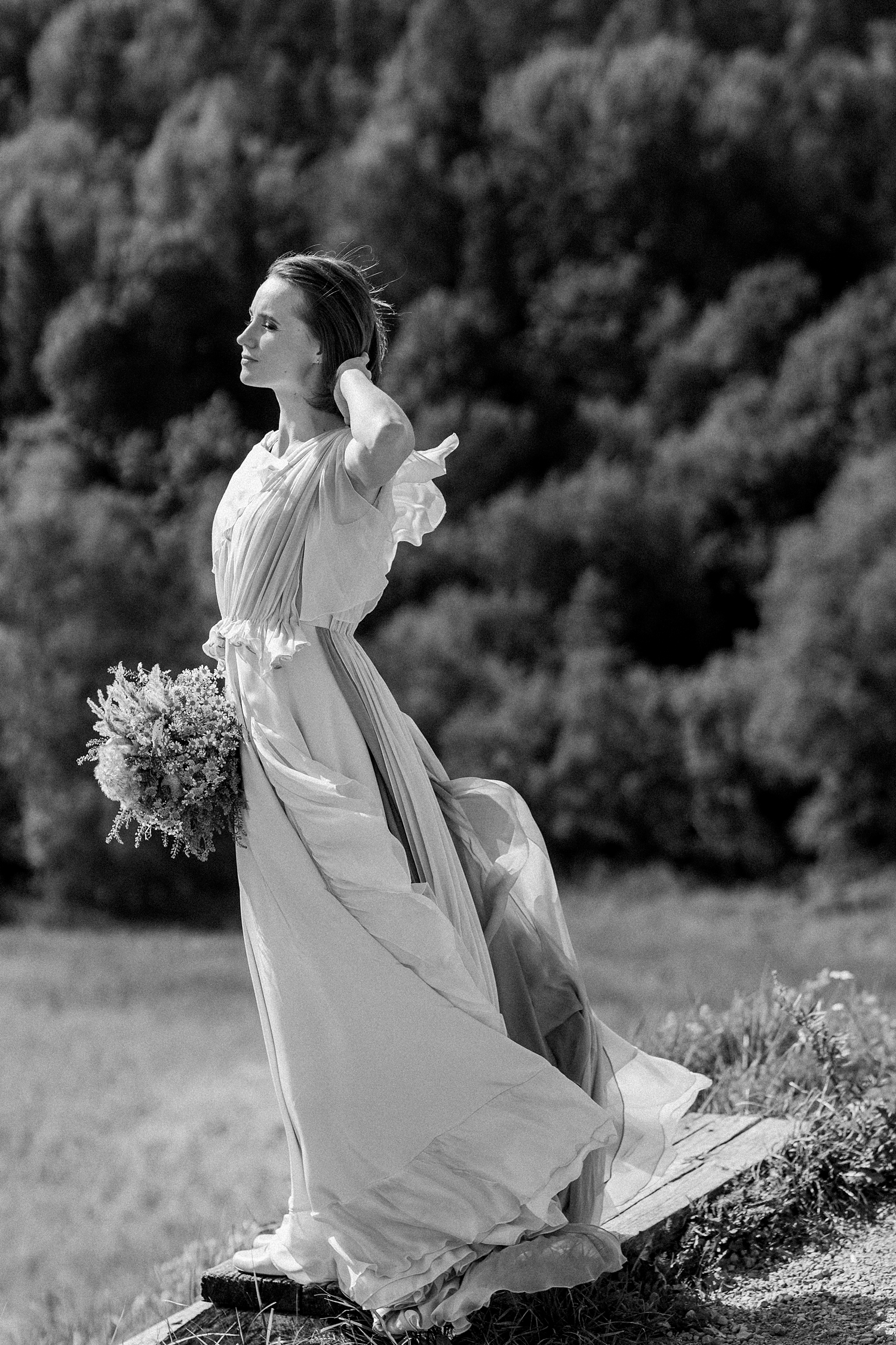 Black and white portrait of bride in gown with bouquet - photo by Jurgita Lukos Photography