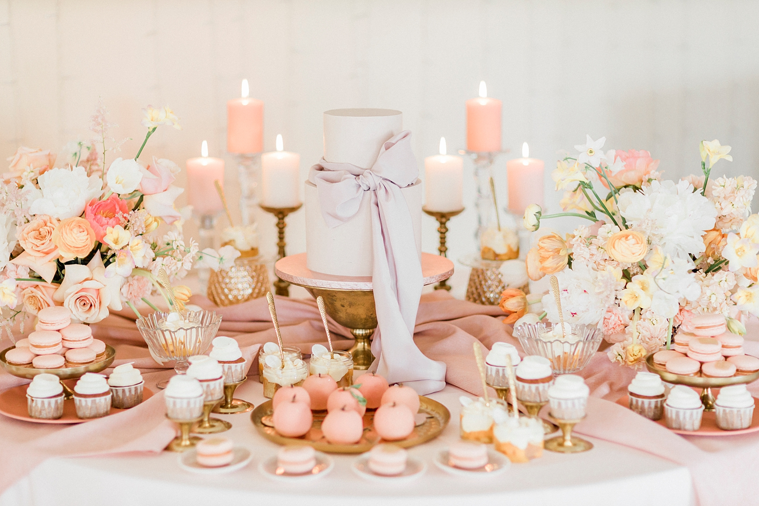 Dessert table in pink and white - photo by Jurgita Lukos Photography