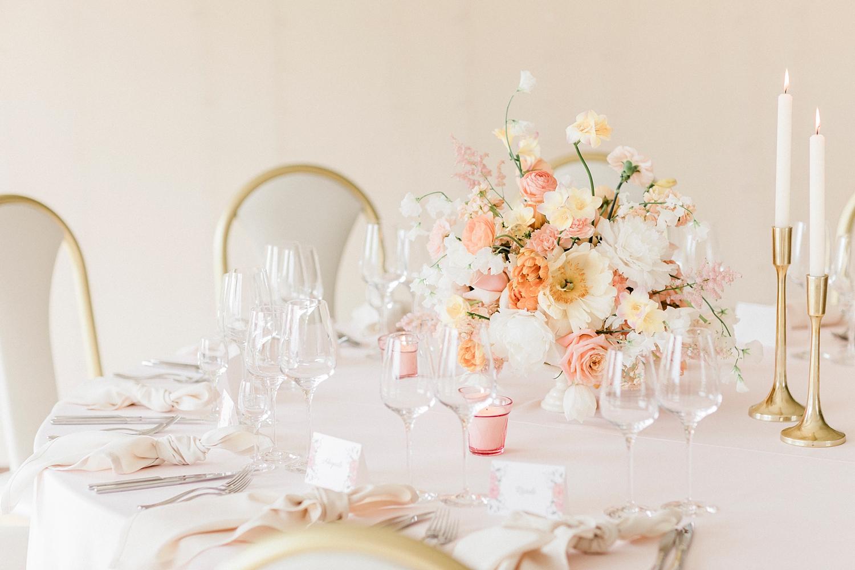 Pastel blush and white centerpiece tablescape - photo by Jurgita Lukos Photography
