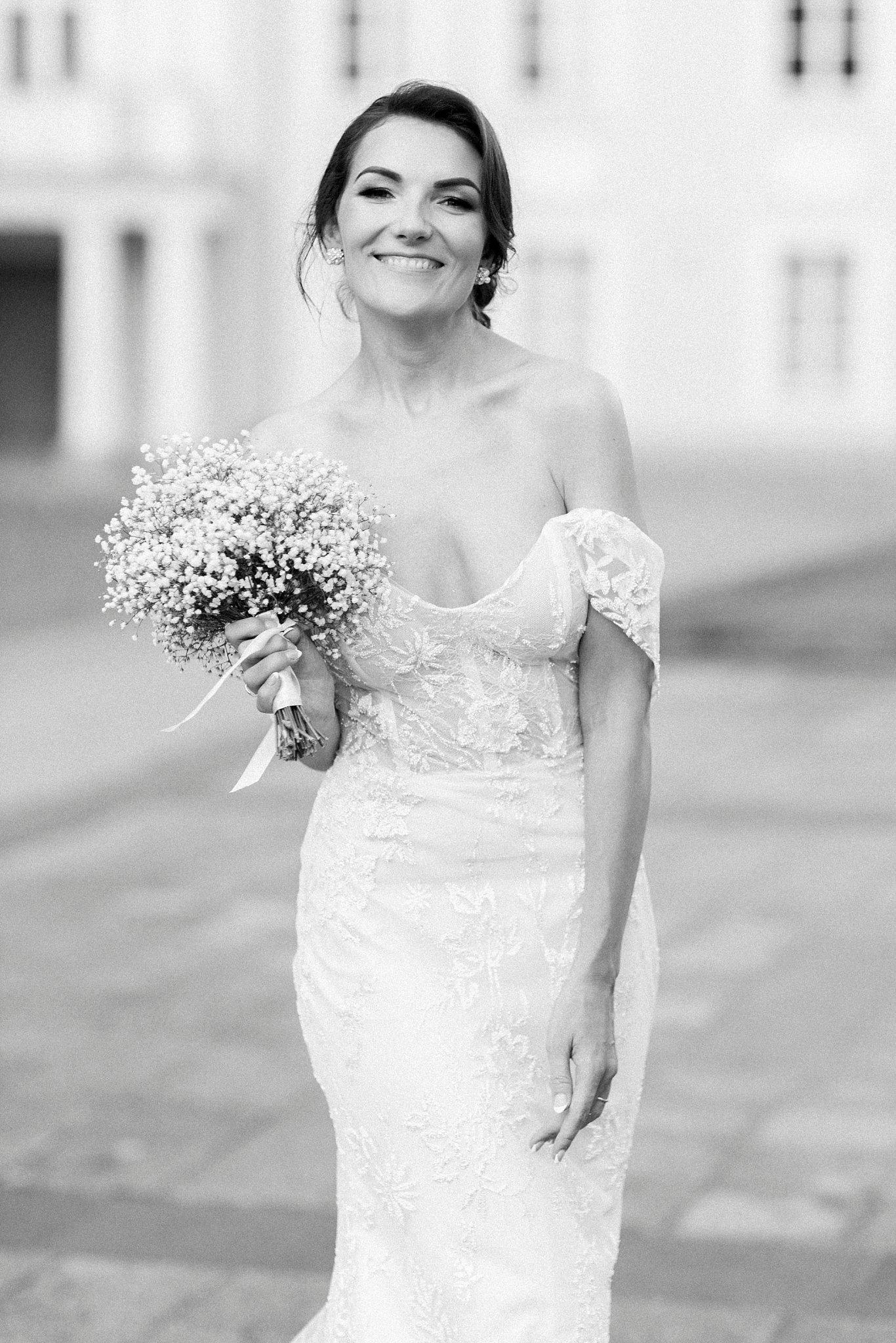 Portrait of bride in off-shoulder lace wedding gown - photo by Jurgita Lukos Photography