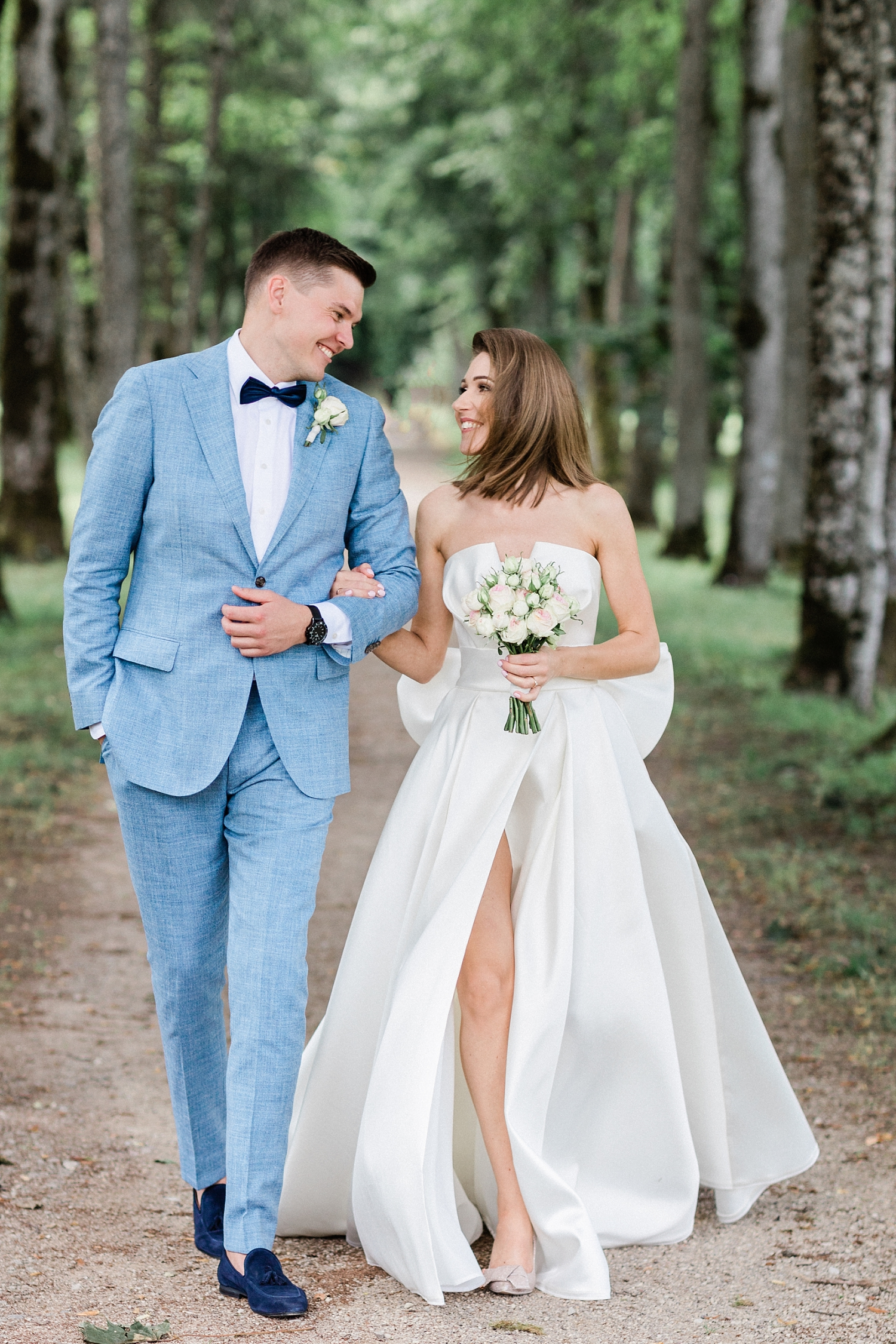bride and groom enjoying a moment together amongst the trees- photo by Jurgita Lukos Photography