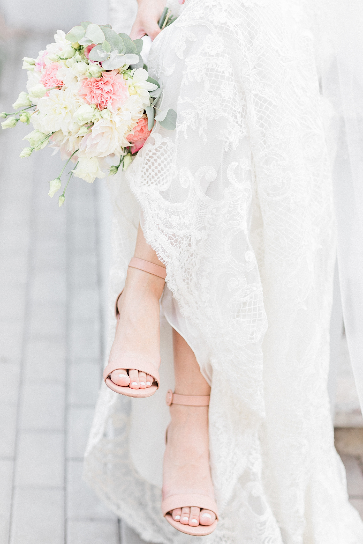 Detail of bridal gown bouquet and shoes- photo by Jurgita Lukos Photography