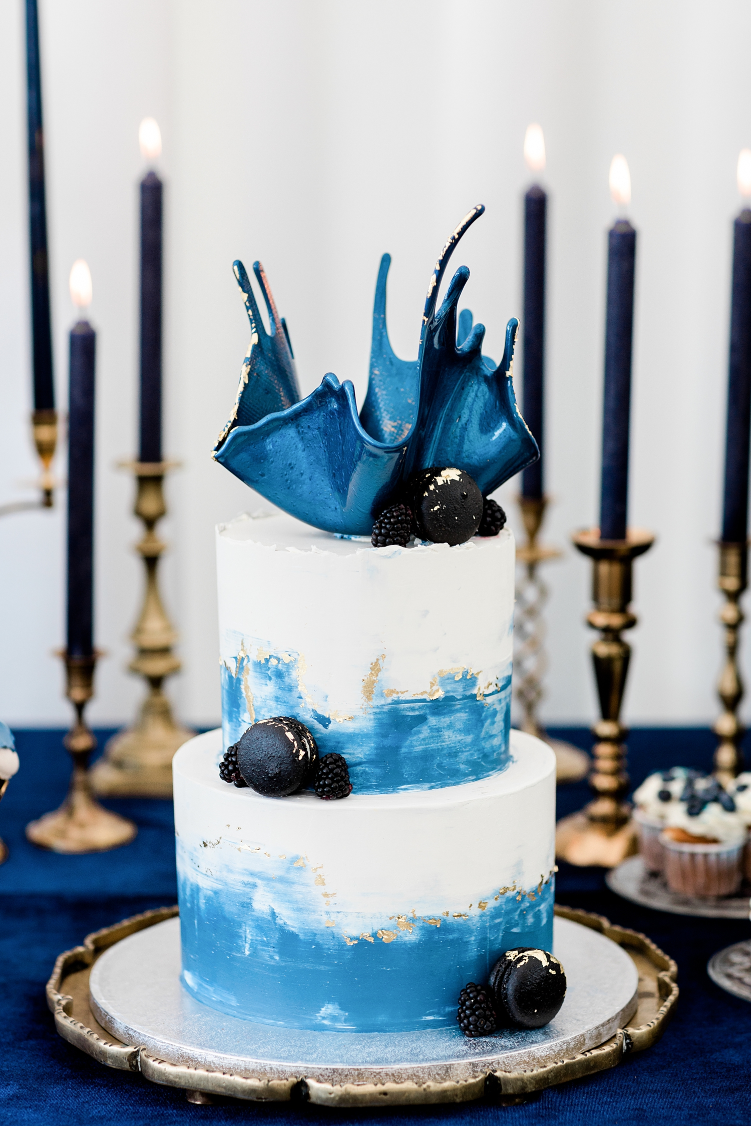 Haute style cake against blue tapers - photo by Jurgita Lukos Photography