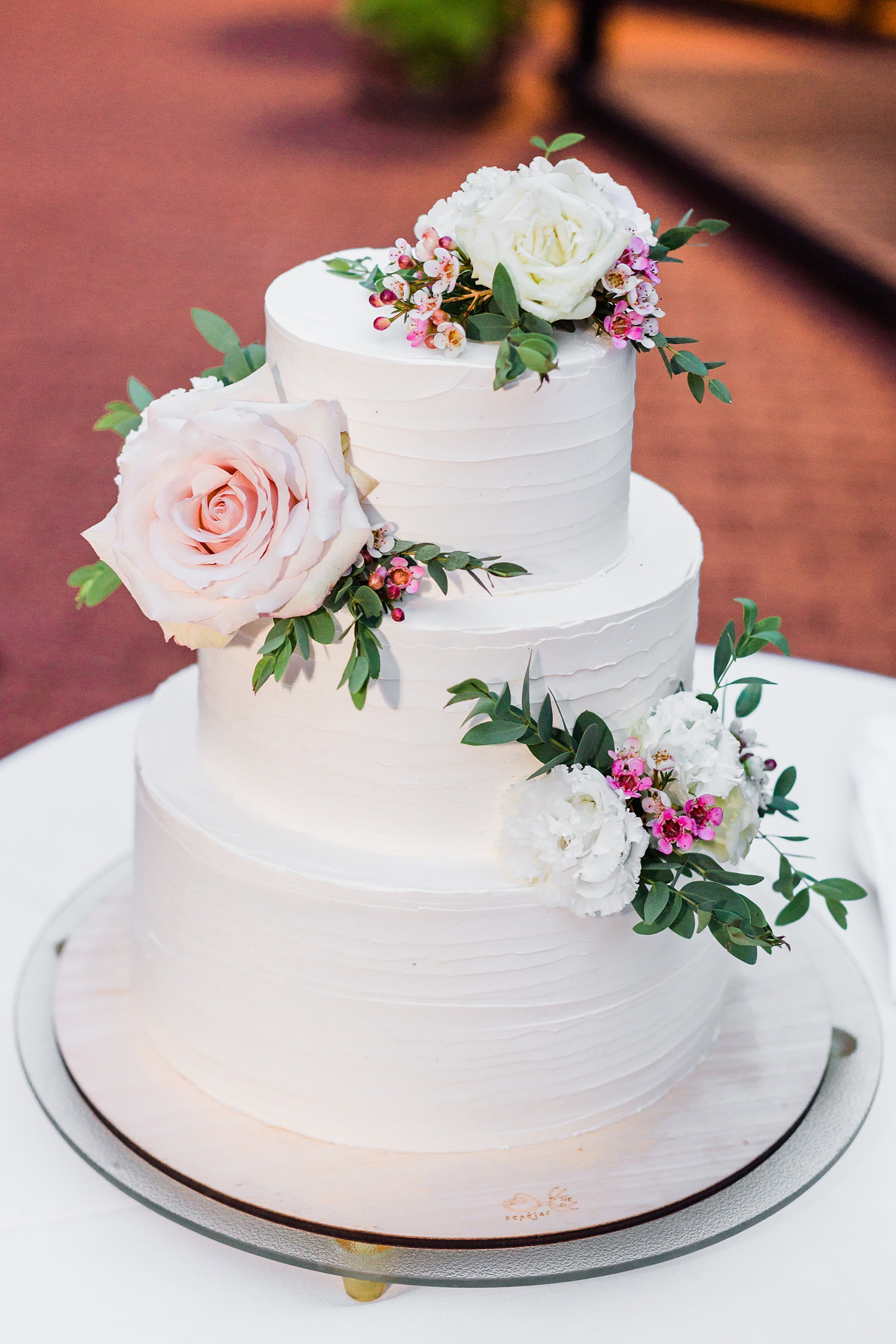 Three tiered cake with roses - photo by Jurgita Lukos Photography