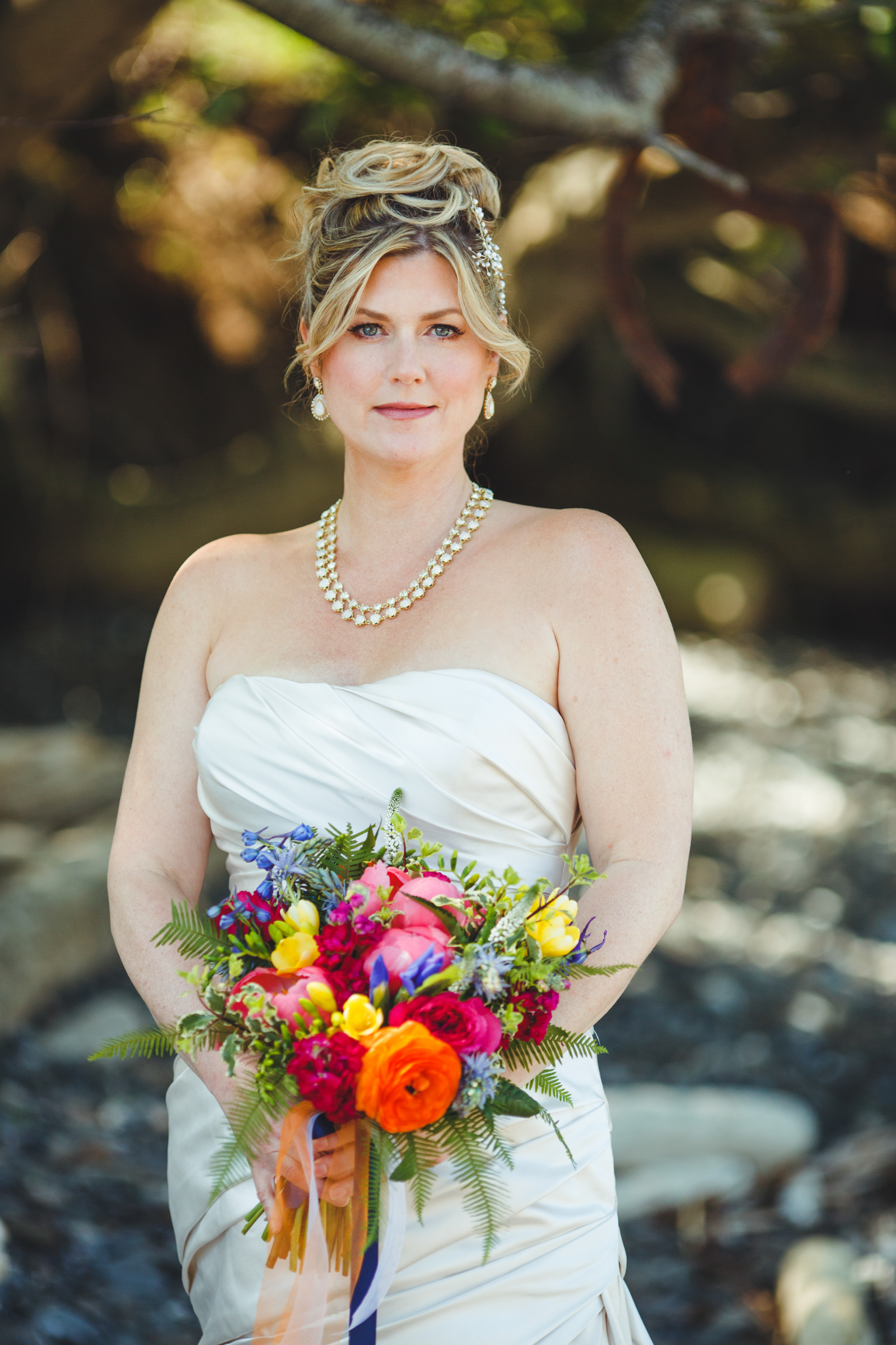 Bride with bright bouquet - photo by Satya Curcio Photography