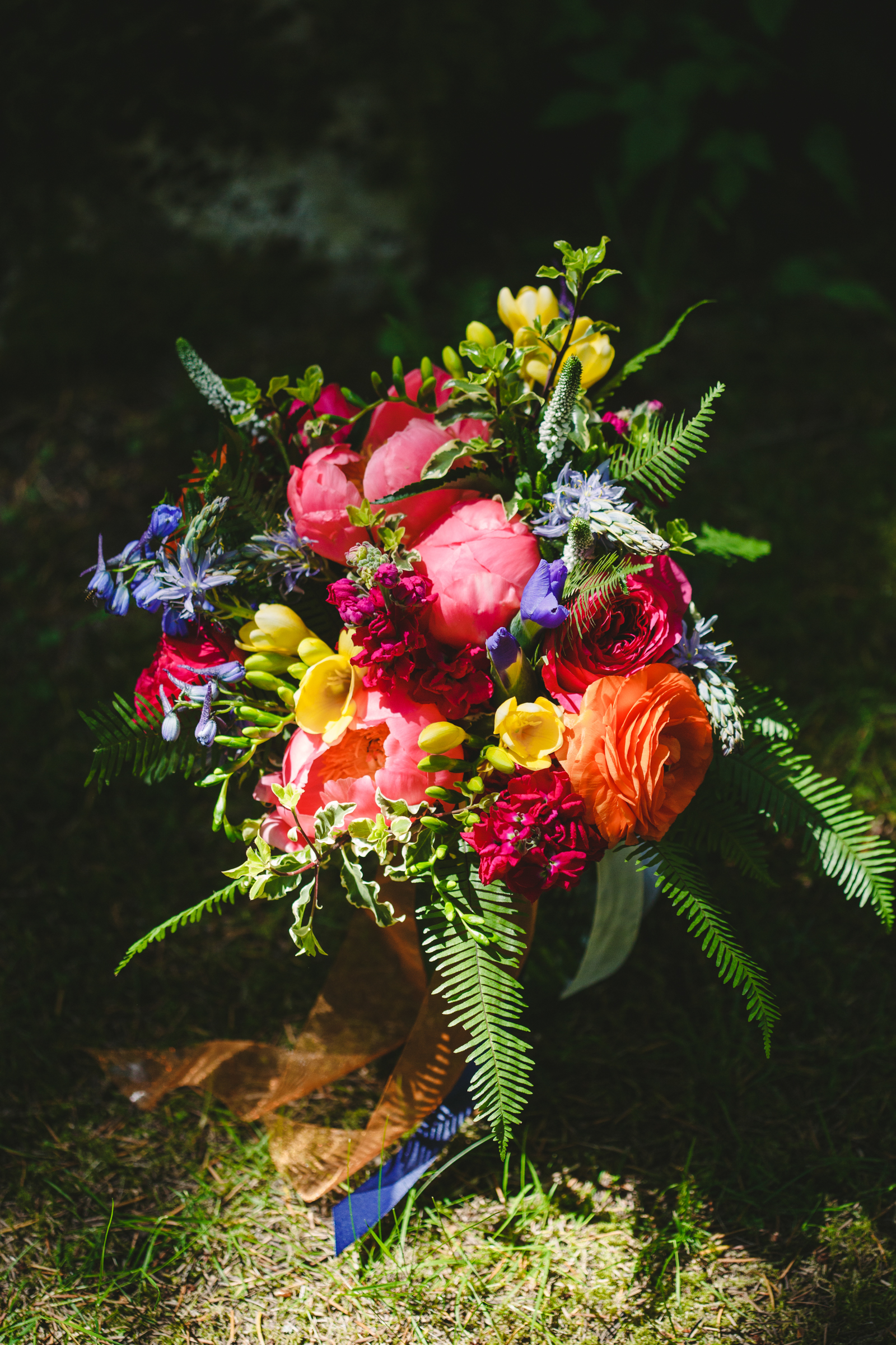colorful bouquet with ranunculus - photo by Satya Curcio Photography