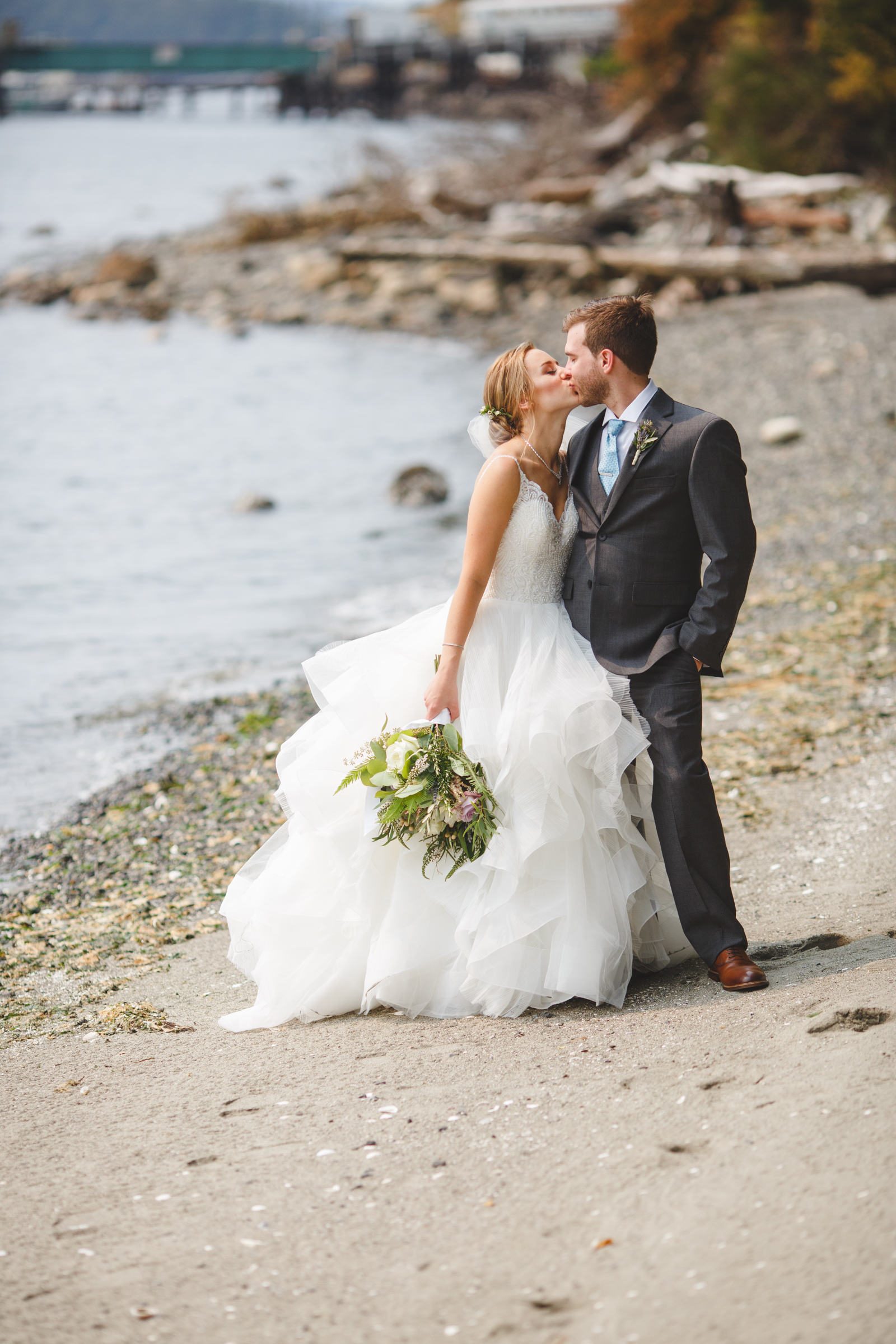 Couple kisses on island beach - photo by Satya Curcio Photography