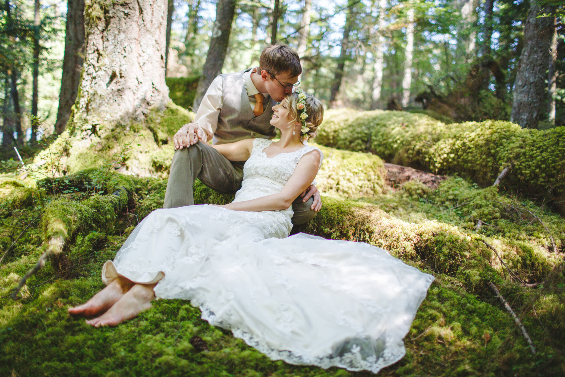 Couple portrait in mossy forest - photo by Satya Curcio Photography