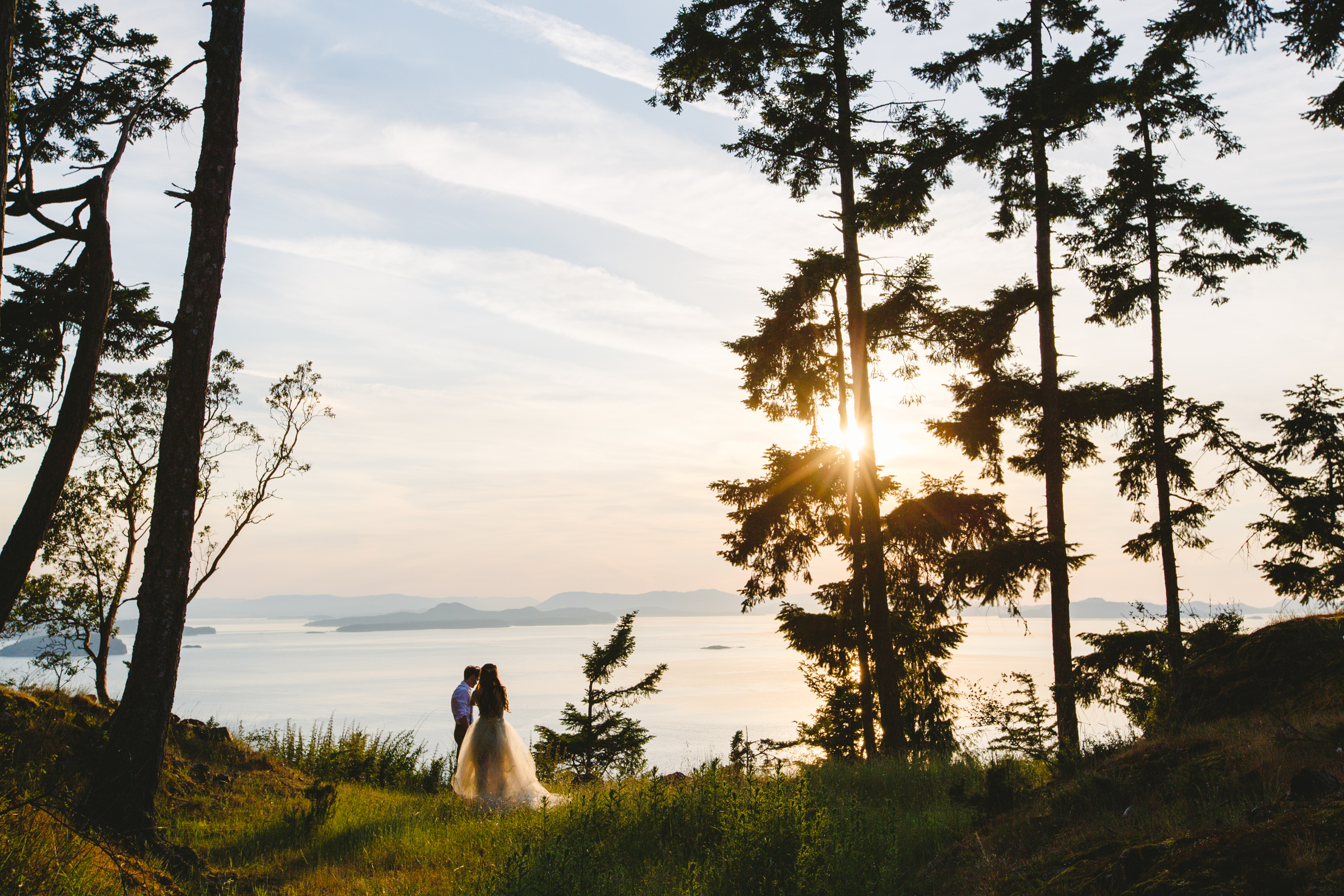 Landscape couple portrait with island view - photo by Satya Curcio Photography