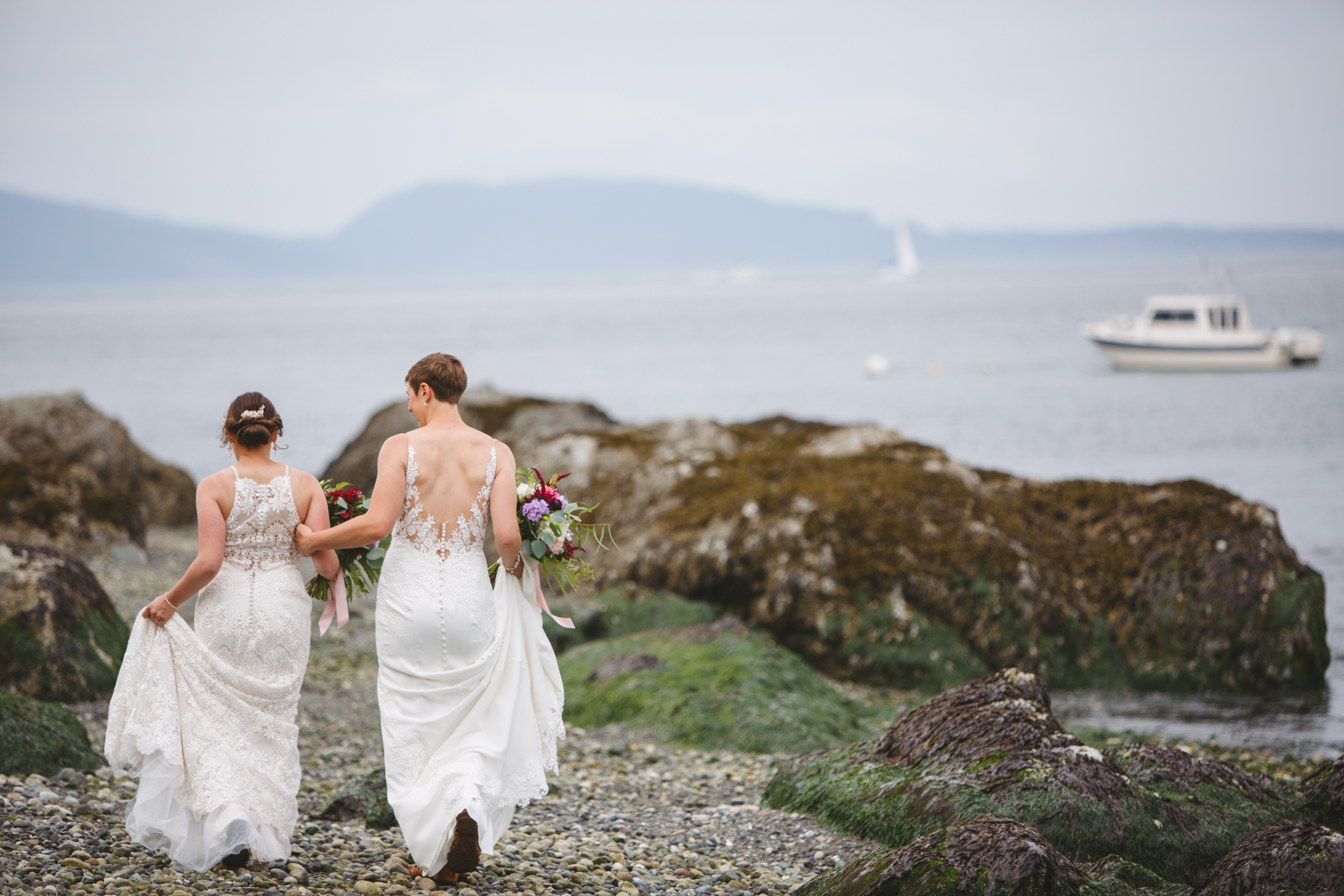 Two brides on island waterfront - photo by Satya Curcio Photography