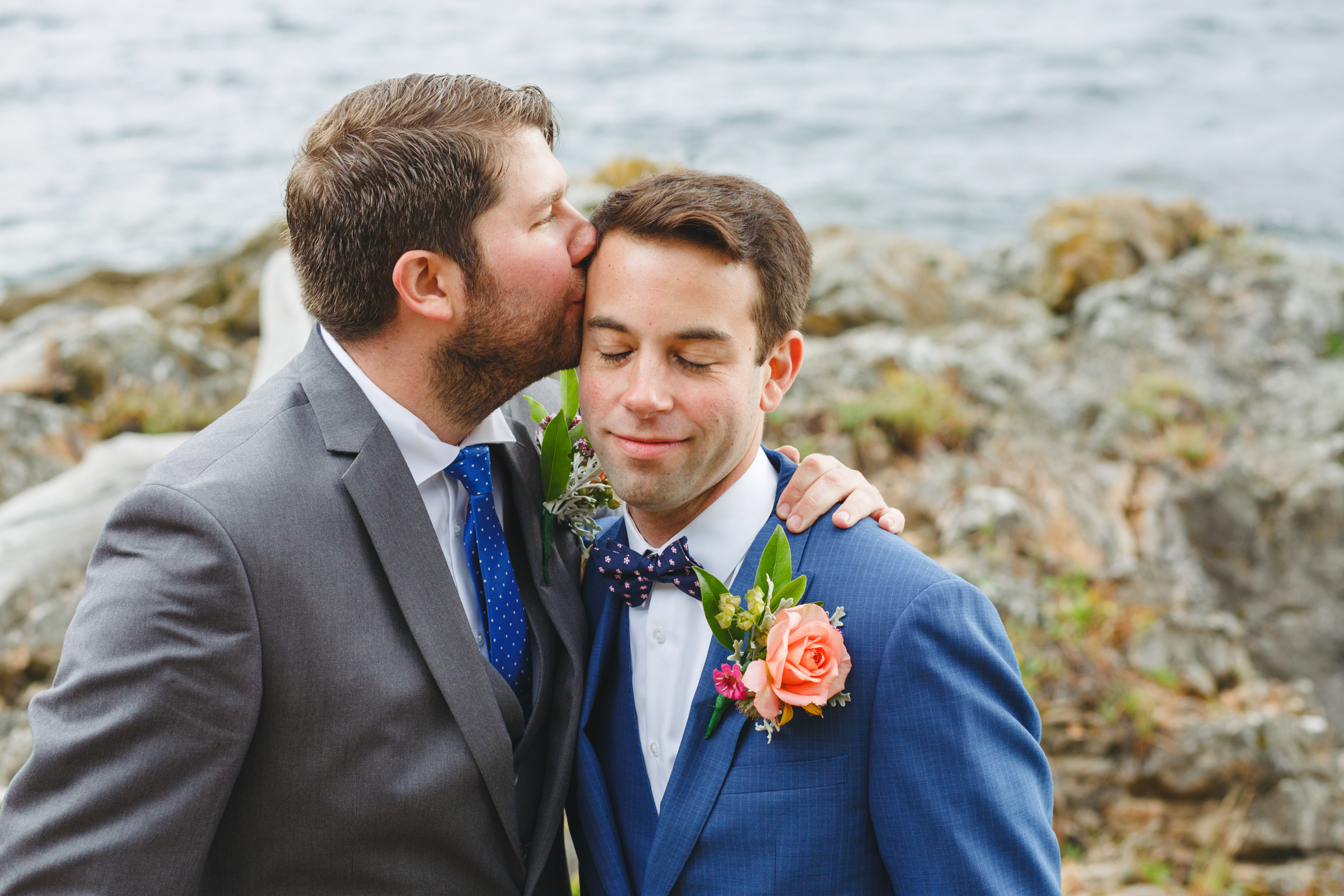Two grooms on island waterfront - photo by Satya Curcio Photography