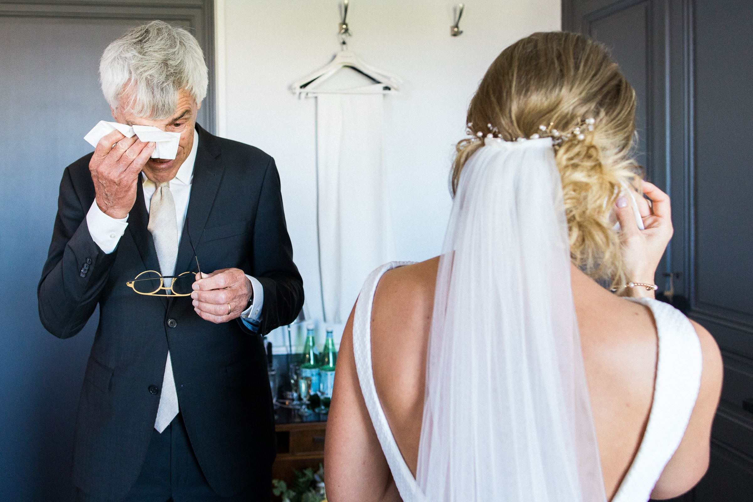 Father and bride tear up at first look - photo by Sylvain Bouzat Wedding Photographer