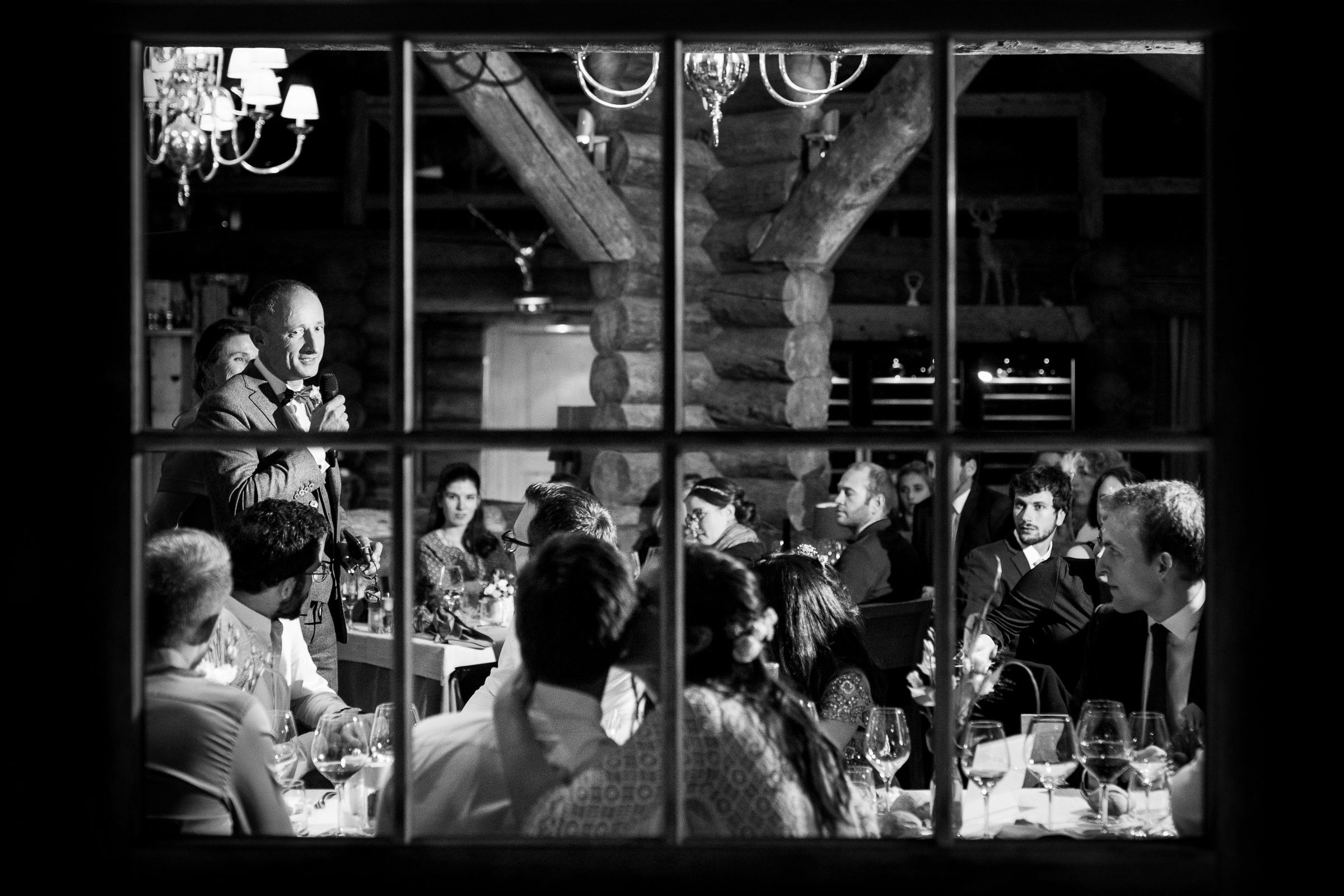 Reception seen through window - photo by Sylvain Bouzat Wedding Photographer